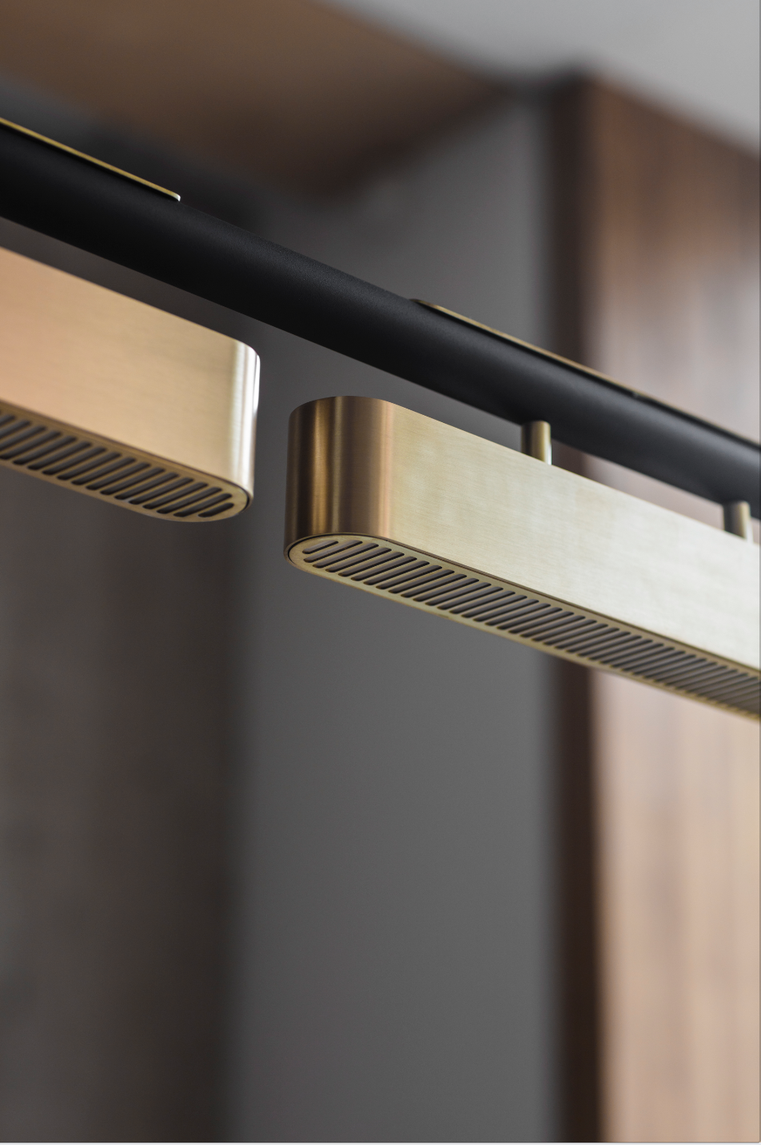 Colt Pendant Light - <p><span>Casting a soft light both up to the ceiling and below, the striking long lines of Bert Frank's Colt Pendant Light makes it the perfect design to hang above a dining table or kitchen island. Three machined brass grills encase opal diffusers for a sophisticated take on urban design.</p> <p></span></p>  | Matter of Stuff