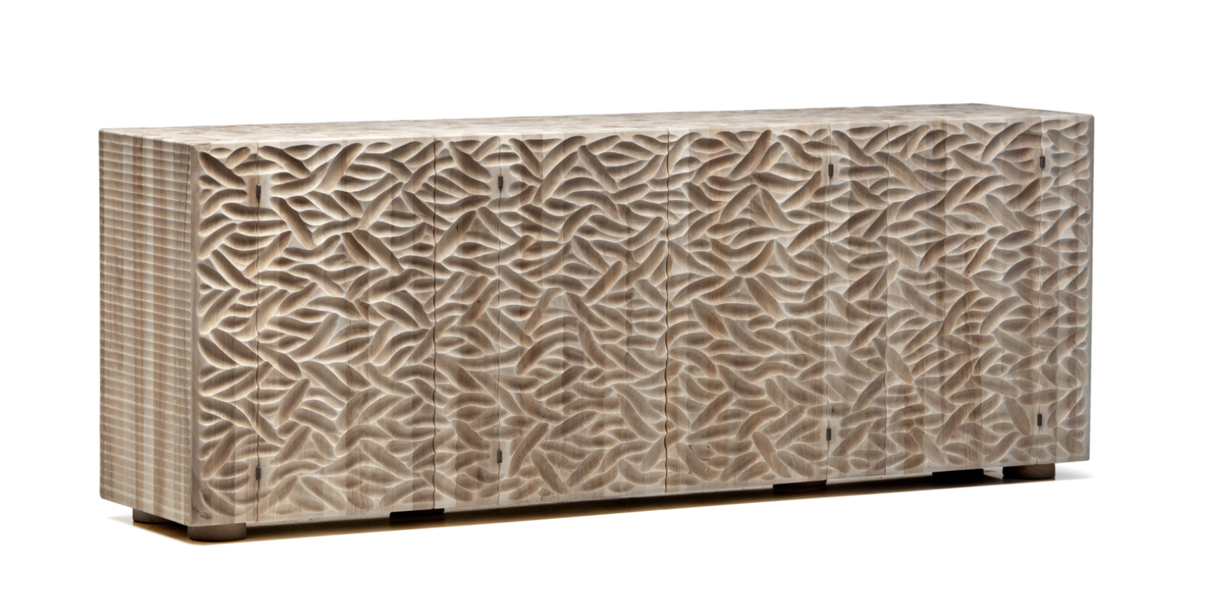 """Pontenove Hand Craved Sideboard - <p>Pontenove is a two-door cabinet made as a single block using wood with vertical grain. It comes in three versions, with different surface finishes. It is manually finished on all sides using a plane and gouge. The burnished steel latches and concealed hinges are specially designed and crafted. The entire manufacturing and finishing process is carried out manually in our workshop. The wood used for this piece is Juglans Regia – common Italian walnut; not dried but """"raw"""". This wood belongs to the Latin tradition of furniture-making and features an extremely compact fibre which can, however, be worked without too much difficulty; it is therefore highly suitable for household items.<br /> The determined shape of this block – a horizontal volume made with a vertical grain – has a minimalist, poetic body which evokes primordial building blocks. Customised and made with Linden wood, European cherry.</p>  