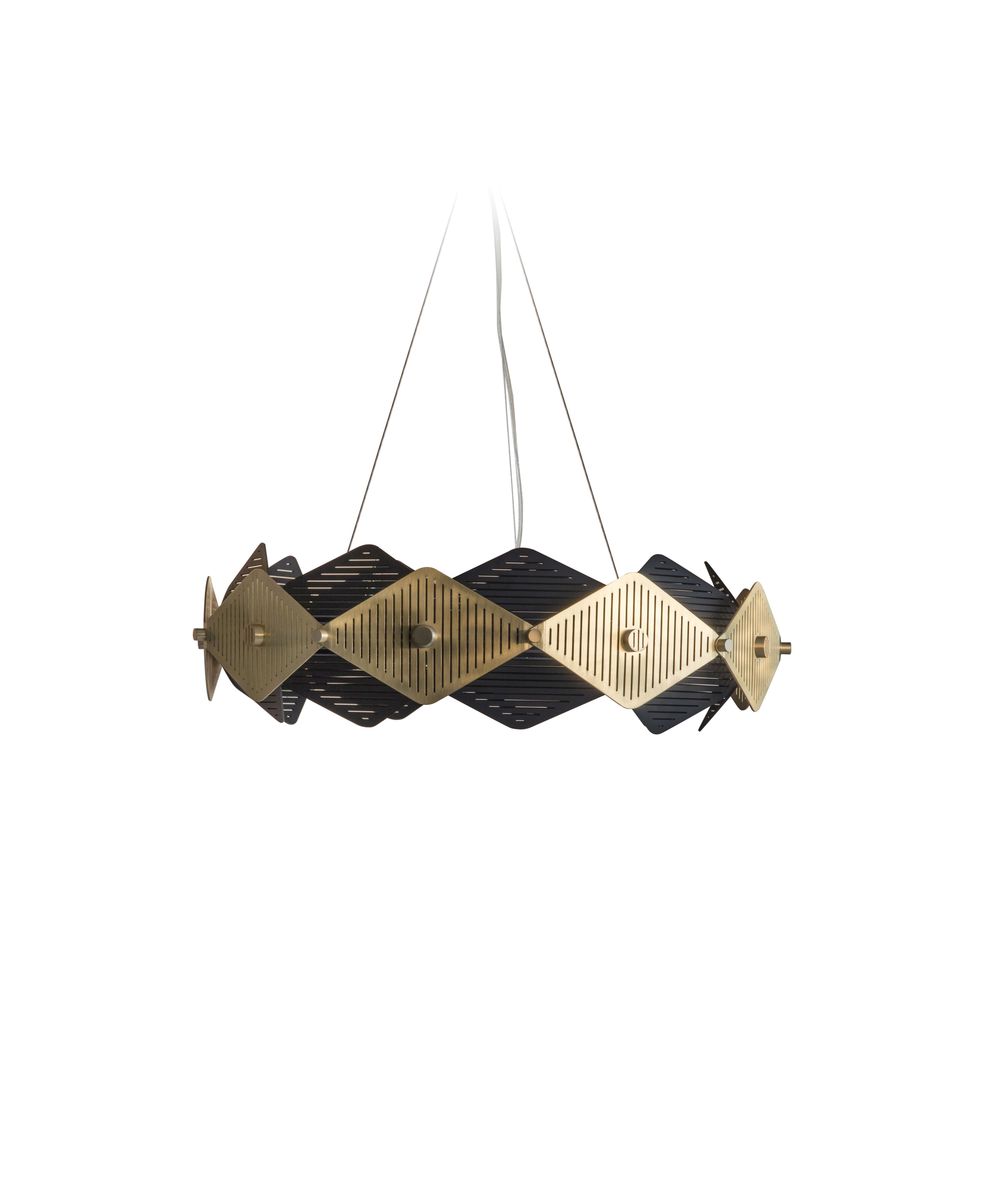 Rote pendant Light - A lattice work of slotted laser cut scales in satin brass and black adorn an internally and externally illuminated brass ring. In this modest scale it is perfect for creating a focal point over smaller dining tables or for use in multiples. A built in Bluetooth module enables total dimming control of the integral LED light source from an app on any smart device.  | Matter of Stuff