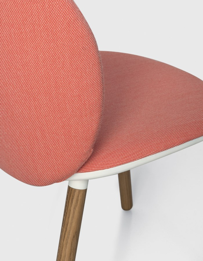 Dua Chair with Four Legs - The Berlin-based studio Läufer & Keichel has created a chair for Kristalia with soft, embracing lines. The name recalls the number two, which recurs throughout the design project starting with the two elliptical surfaces of the seat and backrest, which sensually revolves around the seat. Available with a slide-frame base or with four solid wood legs, the chair and armchair can be upholstered with the fabrics and leather in the catalogue, with the option of different upholstery for the seat and backrest to create contrasting or matching combinations. A range of materials, colours and finishes are available in a number of combinations. Prices may vary. Please enquire for full details. | Matter of Stuff