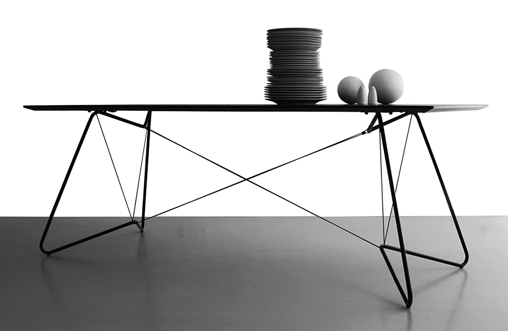 On-a-Strign Table - <p>On-a-string (OAS) Table is an elegant combination of tubes and strings supporting a linoleum or laminated top and is perfectly suited for use as a dining table or an office desk.</p>    Matter of Stuff