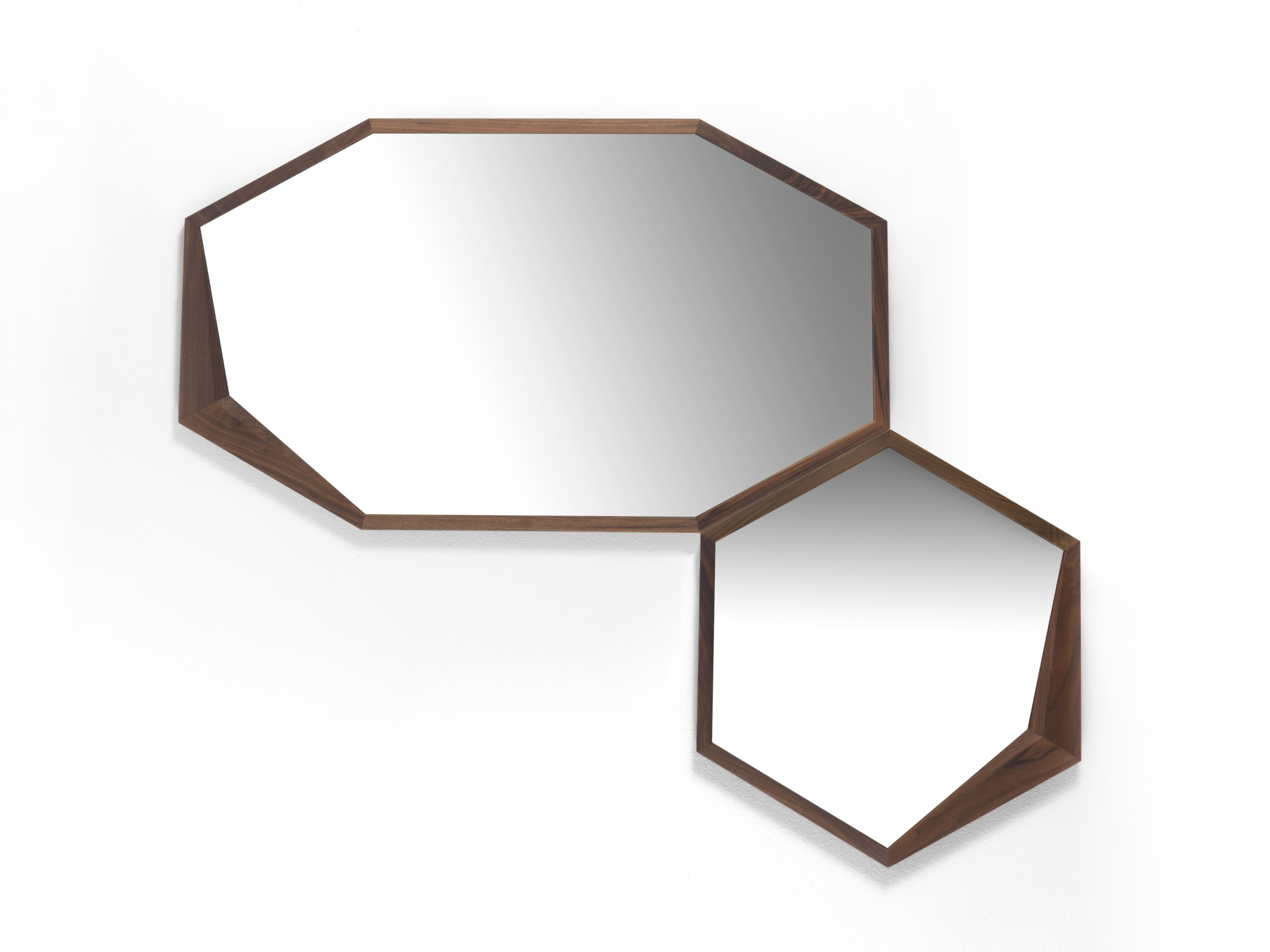 Edes Mirror - The minimalist shape of this hexagonal mirror is framed in an exquisite solid walnut structure that has a charming accent in one of its corners where the wood gets thicker, adding a modern flair to this timeless object of functional decor. A stylish addition to any home, this piece can be paired with the other Edes mirror in this collection for a dynamic look and its wooden frame can be made in solid durmast oak. Just ask the concierge for details. | Matter of Stuff