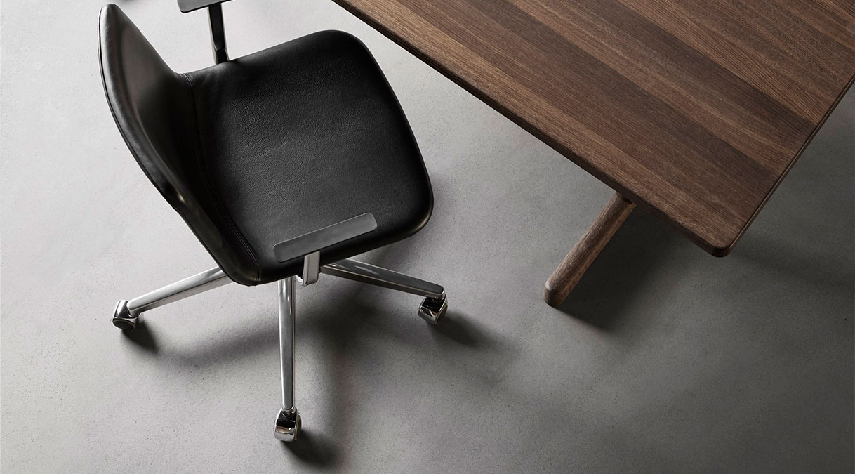 Pato Executive 5 Point Swivel Base Armchair  - Full upholstered office chair with arms, mounted on 5-point swivel base on casters. The frame is height-adjustable with extended flexibility in the seat back. The chair has a higher back than the Pato shell, creating a strong visual appearance.  With the Pato series, Fredericia's legacy of immaculate detailing and craftsmanship meets today's industrial standard - the multipurpose plastic chair. The human-centred design is the work of Danish-Icelandic design duo Welling / Ludvik. Presented in 2013 after nearly three years of development, Pato sets a new standard for the execution and finish of polypropylene material. The series meets every possible contemporary demand for home, office, and public spaces and is available in upholstered versions for extra comfort and different visual statements.  MADE IN DENMARK Pato's polypropylene shell is produced completely in Denmark. Engaging close collaboration with local subcontractors, Fredericia has complete control over all stages of production. All chairs are assembled and quality controlled at our factory in Fredericia.  ECO FRIENDLY Pato is produced in environmentally friendly polypropylene and steel. With it's shell manufactured in Denmark and all other assembly in Denmark as well every chair is fully quality controlled during all stages of the manufacturing process.   The frame is made from quality steel and surface treated with solvent-free powder coating or chrome-plated with Chrome3. The chrome plating complies with lacquer coating standards (DS/EN ISO 1456), thus eliminating any risk of nickel allergy.   At the end of its life cycle, the chair can easily be disassembled for sorting at source. All components are 100% recyclable and can be incorporated into future furniture production.  SUBLIME FINISH AND DURABILITY The chair is tested for durability at the Danish Technological institute and passes at the highest level (Hard use in public spaces). The Pato Shell has a den