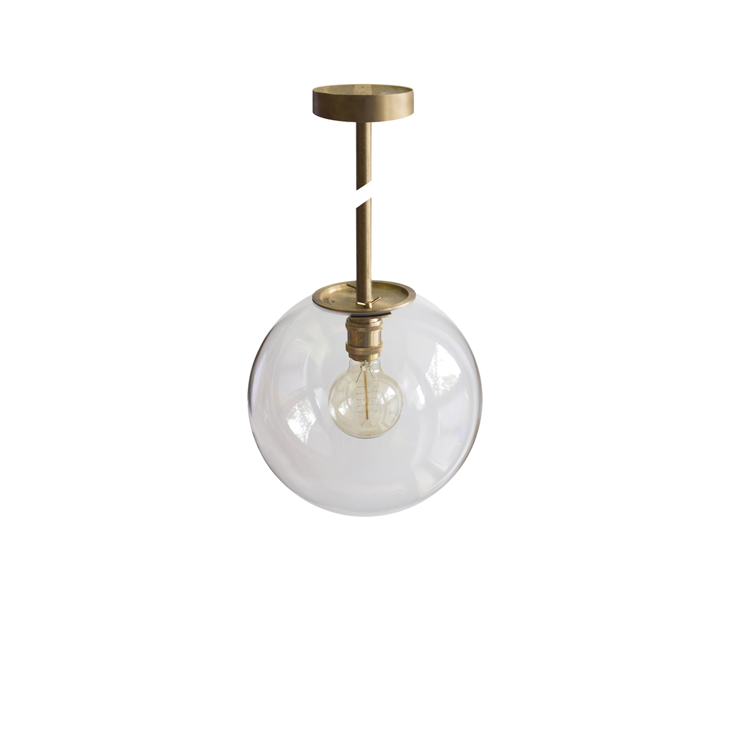 Emiter Pendant Lamp - Emiter hanging lamp is made from the brass elements and glass transparent shade. The hight of the tube can be adjusted - custom made for special order. The lamp has decorative bulb witch provides warm light. The lamp has the certificate. Serial number is engraved on it.  Subtle differences between products are results of hand crafting.   Thanks to the natural properties of brass, lamp will receive an elegant patina finish | Matter of Stuff