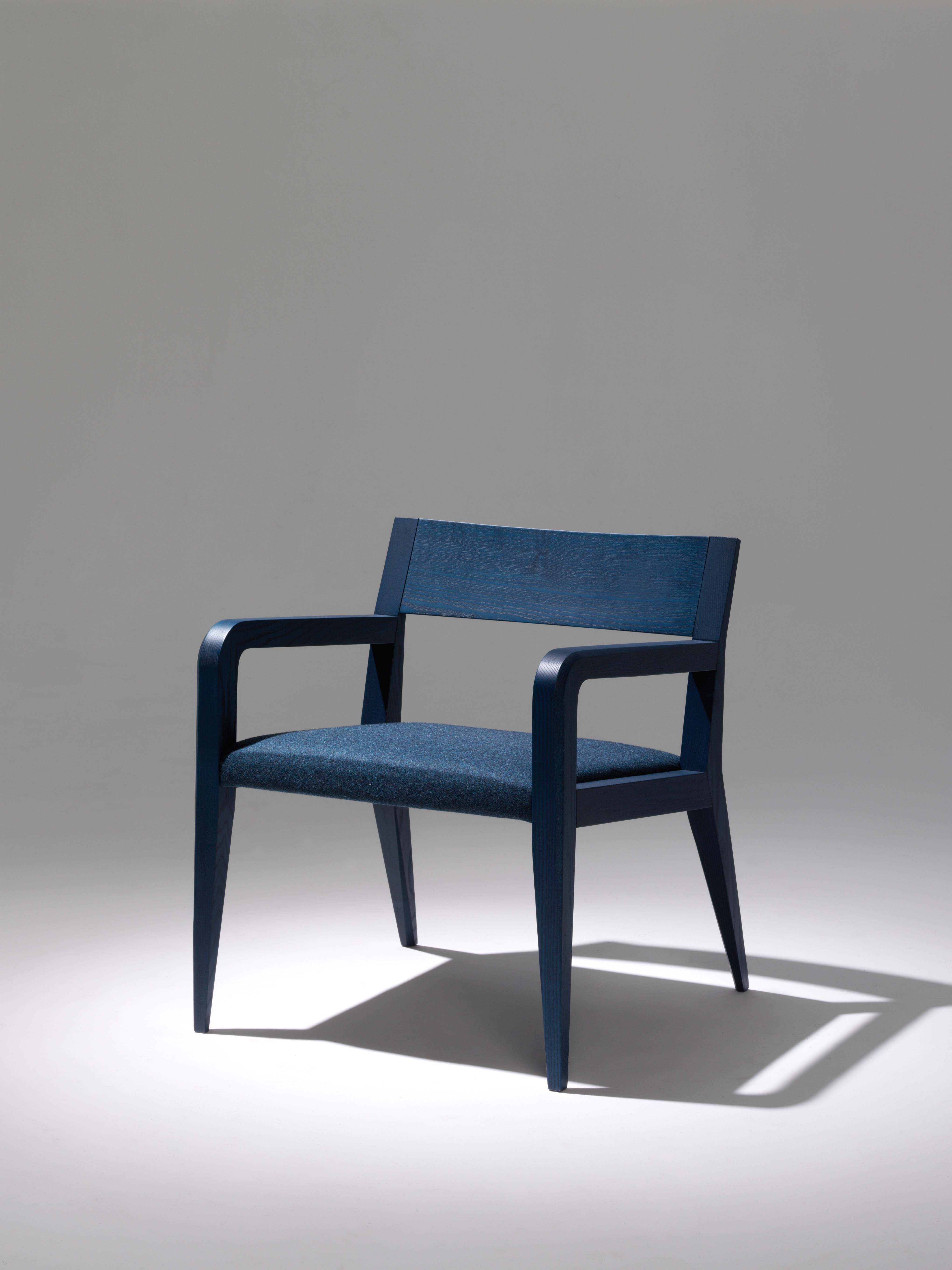 """Aragosta Lounge Chair - <p>A plastic pose. Pointed claws and antennas on a chunky body, hence the name, which means lobster in Italian. </p> <p>The larger parts are rendered lighter through discreet but decisive detail. The woodvein is this crustacean's upper shell, in ashwood. </p> <p>The Aragosta family is the only one available with open pore """"lobster red"""" lacquering, and it comes in stackable dining chairs, lounge chairs and table versions. </p> <p>A range colours and finishes are available in a number of combinations. Prices may vary.<br /> Please enquire for full details.</p>  