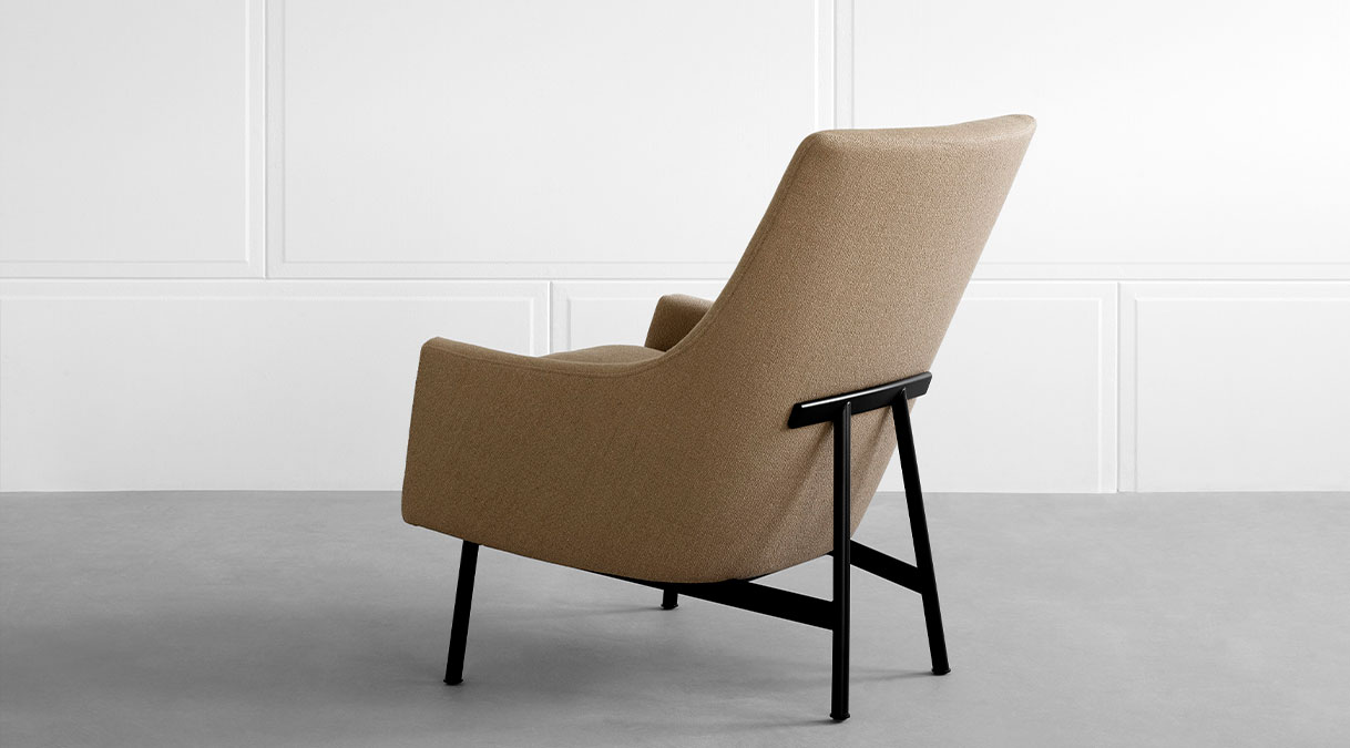 """A Lounge Chair Metal Base - Originally designed by Jens Risom in 1961 the A-Chair is a graceful expression of an elegant, upholstered chair in a timeless design, boasting an A-frame in the back for added support and as signature detail. The curved lines of the two-piece back and loose seat cushion accentuate the comfort and softness of this foam-filled chair with a base available in solid oak, walnut, black lacquered steel or matt chrome.  Jens Risom known for introducing a Scandinavian design sensibility to the American market. There he pursued a successful career designing an array of pieces which stemmed from functionality, imbued with a New York sense of style and savoirfaire. Risom went on to leave a legacy of stunning, streamlined designs.   Echoing his sentiment that """"when sizing up a chair, do it sitting down"""", Risom's design of the A-Chair fuses comfort with a well-tailored sense of class. The A-frame in the back cradles the entire chair, and what began as a functional detail became the signature trait. The slight angle of the back is mirrored in the angles of the arms, adding a sense of equilibrium to the leaned back look. The twopiece back and seat cushion add comfort and are discretely incorporated into the design as graphic elements.   It's graceful, comfort-conscious chair driven by a purpose. Originally conceived in 1961, the A-Chair will always look modern in any milieu, exquisitely executed so lounging becomes a luxury.  