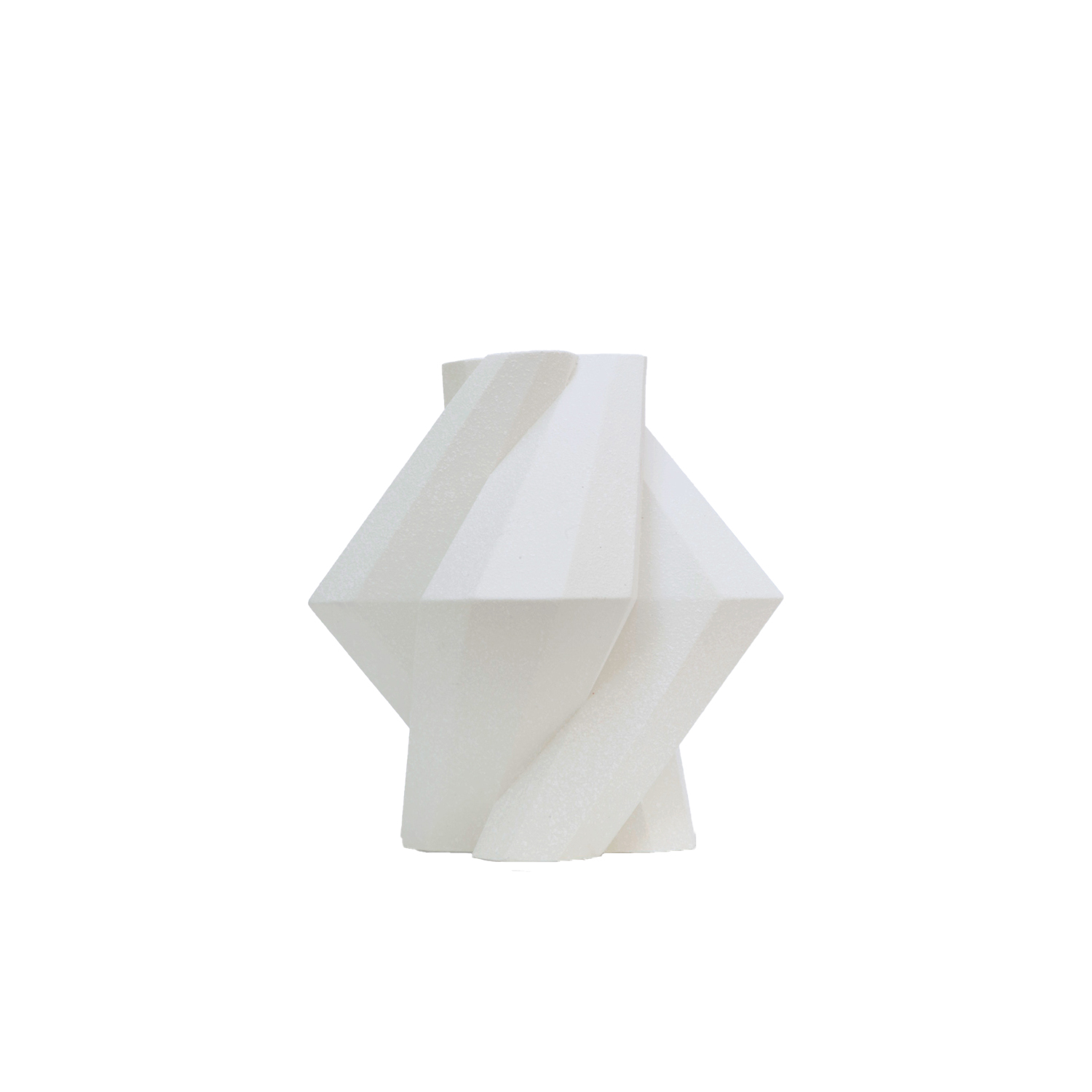 Fortress Pillar Vase White - Designer Lara Bohinc explores the marriage of ancient and futuristic form in the new Fortress Vase range, which has created a more complex geometric and modern structure from the original inspiration of the octagonal towers at the Diocletian Palace in Croatia. The resulting hexagonal blocks interlock and embrace to allow the play of light and shade on the many surfaces and angles. There are four Fortress shapes: the larger Column and Castle (45cm height), the Pillar (30cm height) and the Tower vase (37cm height). These are hand made from ceramic in a small Italian artisanal workshop and come in three finishes: dark gold, bronze and speckled white.  | Matter of Stuff