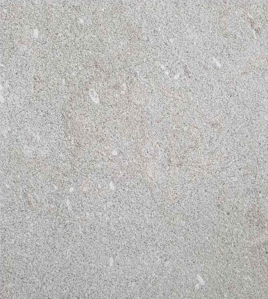 Grolla Grigio Olivo Sandblasted - Grolla hard limestone, the company's flagship product, is a versatile and resistant material because it lends itself to all types of processing.  What distinguishes this stone from the others are its extraordinary certified technical-mechanical characteristics, such as low water absorption, resistance to abrasion, salt, pollution and frost.  Thanks to these peculiarities, Grolla is suitable to the realisation of outdoor projects (ventilated and glued facades, floors, swimming pools) and interiors (wall coverings, floors, bathrooms, kitchens, objects and furnishing elements such as sinks, shower trays, tubs, tables and much more).  The colors of the Grolla range from beige to intense pink shades, passing through grey.  The remarkable technical characteristics, combined with the aesthetic qualities of this stone, adapt to suited to styles, architectural contexts and design from classic to contemporary, perfectly matching with wood, glass, steel and other materials.  Interiors and exteriors, classicism and contemporaneity: for Grolla, every solution is possible. | Matter of Stuff