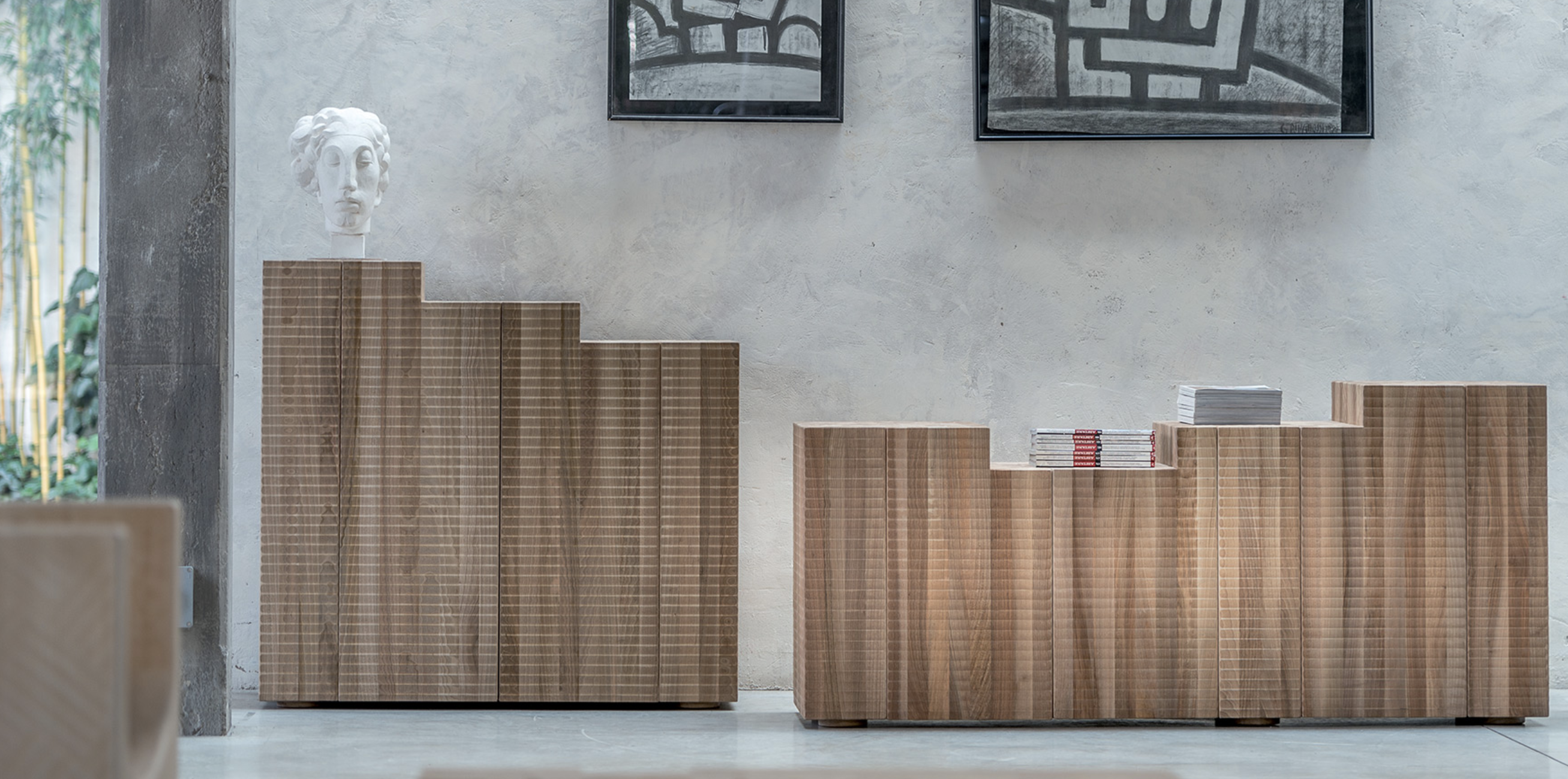 """Nova Sideboard - <p>Nova is a cabinet made as a single block using wood with vertical grain. It comes in two-door cabinet or four-door sideboard versions. It is manually finished on all sides using a plane and gouge. Latches and hinges are concealed.<br /> The entire manufacturing and finishing process is carried out manually in our workshop.<br /> The wood used for this piece is Juglans Regia – common Italian walnut; not dried but """"raw"""".This wood belongs to the Latin tradition of furniture-making and features an extremely compact fibre which can, however, be worked without too much difficulty; it is therefore highly suitable for household items. Over time the wood hardens and becomes extremely resistant, and oxidises slightly to take on a progressively warmer amber colour. The living space is brought to life by people, but furniture also helps to make the space liveable and human: the terraced surface of this austere horizontal cabinet is almost an invitation for free, joyful use of the item for containing, displaying, sitting or climbing. Customised and made with Linden wood, European cherry, Slavonian oak, maple.</p>  