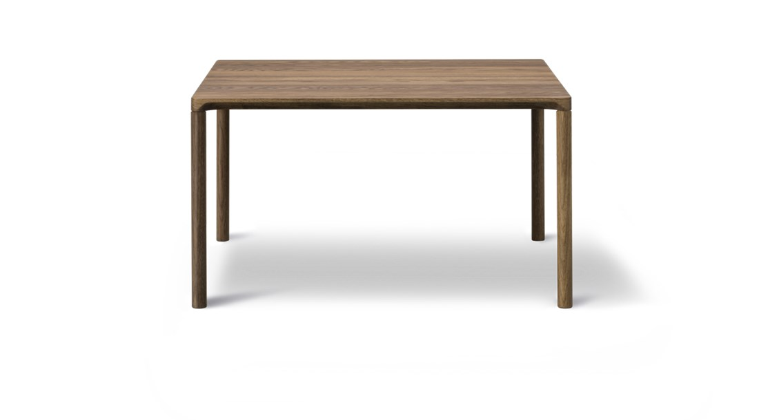 """Piloti 6720 Side Table - Piloti is a series of solid oak side tables. The subtle detailing of the table top creates the impression of a single line, floating between four delicate legs. The tables are supplied in two heights and can be combined as a nest.  The word """"piloti"""" refers to the pillars or columns that elevate a building above the ground. While the legs of our Piloti Tables resemble pillars, the overall intention is for the table to appear like a slim line almost floating in space.   An elegant integration of the table top with the legs ensures a subtle, streamlined transition into one balanced entity.   Light in appearance yet sturdy in construction, the Piloti tables in wood are made from solid oak, a naturally beautiful, tactile material that needs no adornment. The option of different sizes gives you the freedom to cluster the tables together in a corner or as part of a sofa set-up. Place them individually as side tables or as a matching pair on either side of a bed.  