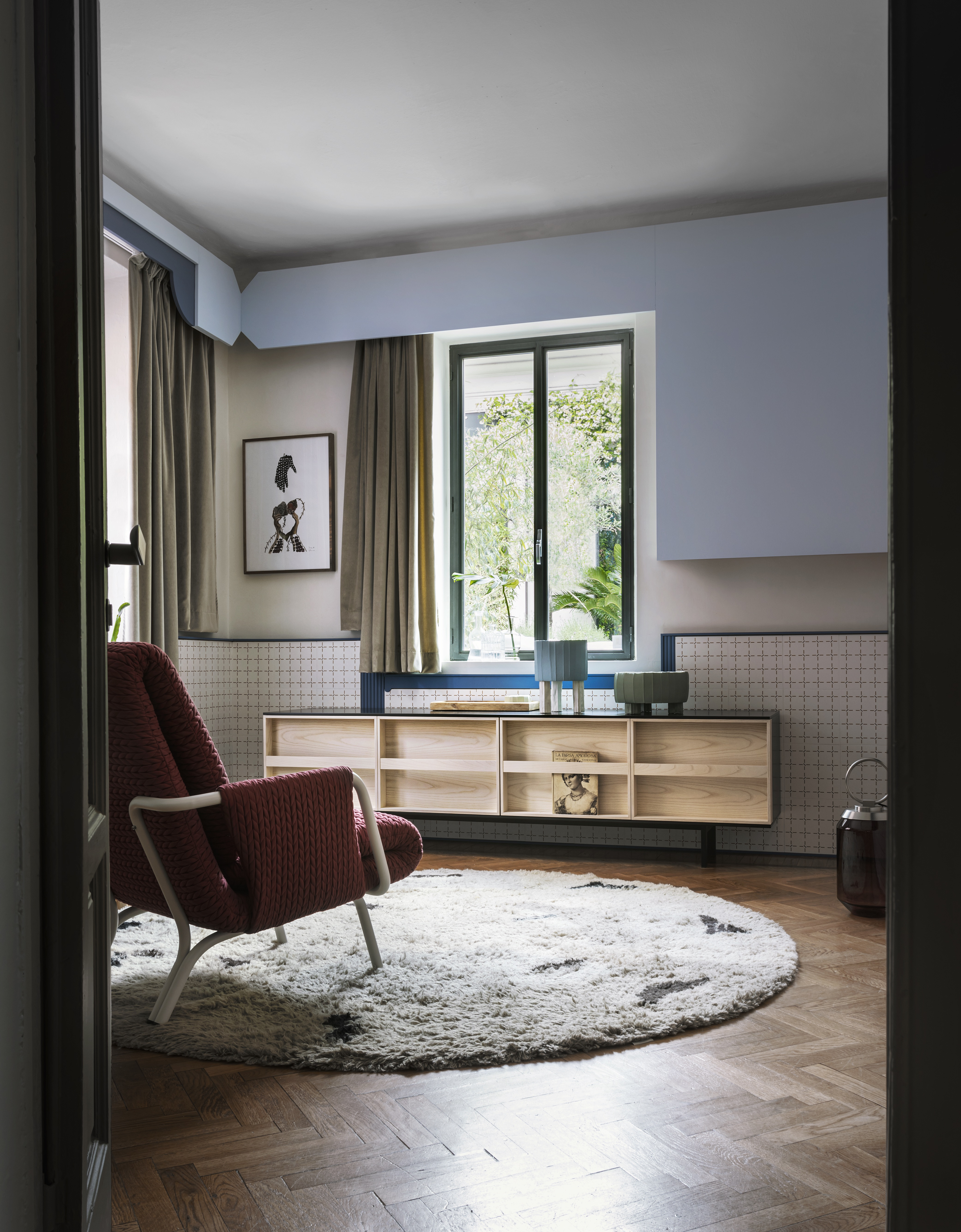 Ramblas Large Sideboard - Evocative, with thin wooden lines and a minimalist charm. The sideboard is characterized by doors designed as a library and equipped with an effective book-like opening system. It is available in three different sizes.    Matter of Stuff
