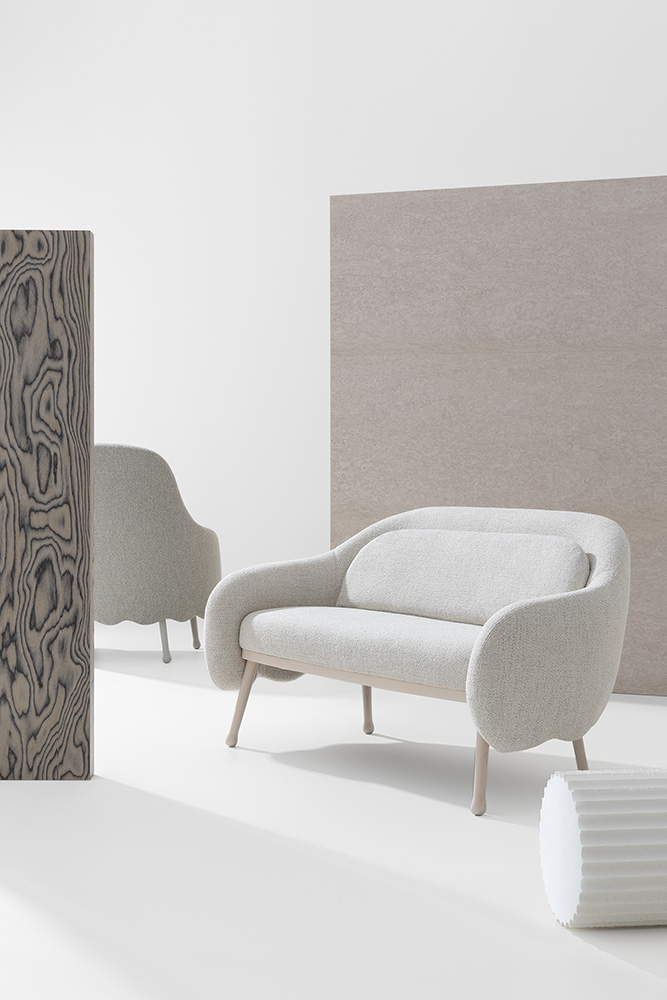 Corolla Sofa - This sofa, designed by Cristina Celestino, is a simple but elegant addition to your home. The wavy back adds personality and the shape is designed with comfort in mind. This is the perfect thing for small spaces or entrance ways and hall ways. The legs are slightly slanted and come in either Ash, Beech or Lacquered Beech. The upholstery can be fabric, leather or your chosen material.  This can come with cushions. Please enquire for more information.     Matter of Stuff