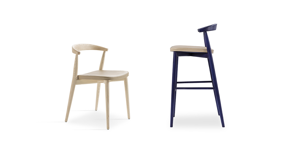 Newood Light Chair - BrogliatoTraverso studio has continued to amplify its celebrated family, inspired by classic Windsor chairs, this time in two ultra-light versions: Newood Light chair and Newood Light stool.   The Newood Light chair reflects all of the characteristics of the original design, but is much lighter in weight, due to the elimination of the 8 rods in the backrest.   Newood Light Stool, a new item for 2019, is available in two heights and is made of solid ash wood, in the same tones as the other seats in the collection.   Both the stool and Newood Light chair are available in a bleached ash, wengé stained, black stained oak stained and Shanghai blue stained finish. The seat can be in beech plywood seat, ash veneered in the same colour of the structure, or padded with fixed cover in a selection of fabrics or leathers of the collection. | Matter of Stuff