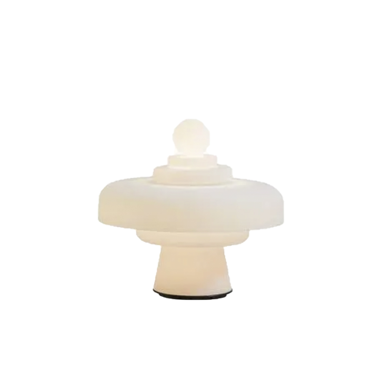 Regina Table Lamp - Inspired by the game of chess with their sinuous shapes, Re and Regina are the key characters of the chessboard. Their profiles stand out clearly in the white light diffused by opalescent glass. Real individuals, they play in pairs alternating spheres, cylinders and rings of light. Vertical the King (Re), horizontal the Queen (Regina). They can be placed next to each other or in different spots in the same room, be used as floor or table lamps, on a coffee table or a desk, both Re and Regina have the presence to create a context. The dimmer allows to modulate the light making it a surreal element with different degrees of intensity: an element of representation that releases energy in space when the light is bright, abstract and restful when the light is soft and low. Glass sculptures during the day in environments illuminated by natural light. Re and Regina are inspired by the history of art, from Cosmè Tura to the Flemish interiors of Jan Van Eych to the conceptual imagery of Marcel Duchamp who plays chess as a lifestyle. Re and Regina are Cartesian axes of a universe that crosses ages and cultures. In 2020 FontanaArte reintroduces these glass lamps as a sign of the expressive wealth contained in the great repertory of ideas that is the FontanaArte catalogue and, most importantly an homage to the talent of an artist who had a gift for calibrating the formal tension of a utilitarian object on a quest for unity among the arts.  Dimmable diffused-light table or floor lamp. Painted metal frame. Diffuser in satin-blown glass.  Black power cable, dimmer and plug. Power supply with interchangeable plugs (europe - usa). Integrated LED. | Matter of Stuff