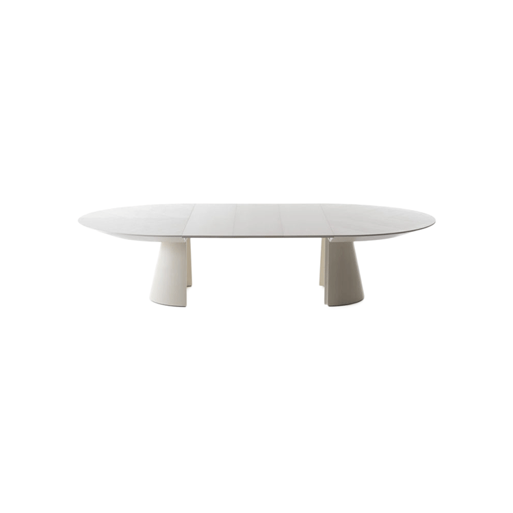 Adagio Extensible Table - Soft and essential lines characterize the Adagio extensible table. The apparent simplicity of form and minimal style hide in the other hand, the high-tech Bauline mechanisms, which allow great extensibility and the internal storage of the leaves.  | Matter of Stuff
