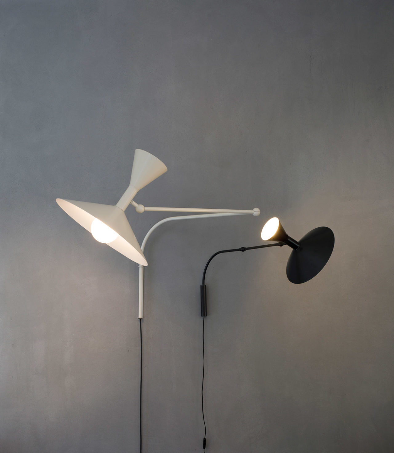 Lampe de Marseille Wall Lamp - <p>Designed by Le Corbusier for the Unité d'Habitation of Marseille in 1949/1952, Lampe de Marseille is an adjustable wall lamp with two joints on the arm and a rotating wall fixing.<br /> Also available in the MINI version with reduced dimensions.<br /> Spun aluminium diffuser. Available with matt grey, whitewash or black body, with white internal diffusers.<br /> Direct and indirect lighting output. Double switch on the cable, for functional and adjustable light output.</p> <p>Prices are with bulb excluded.</p>  | Matter of Stuff