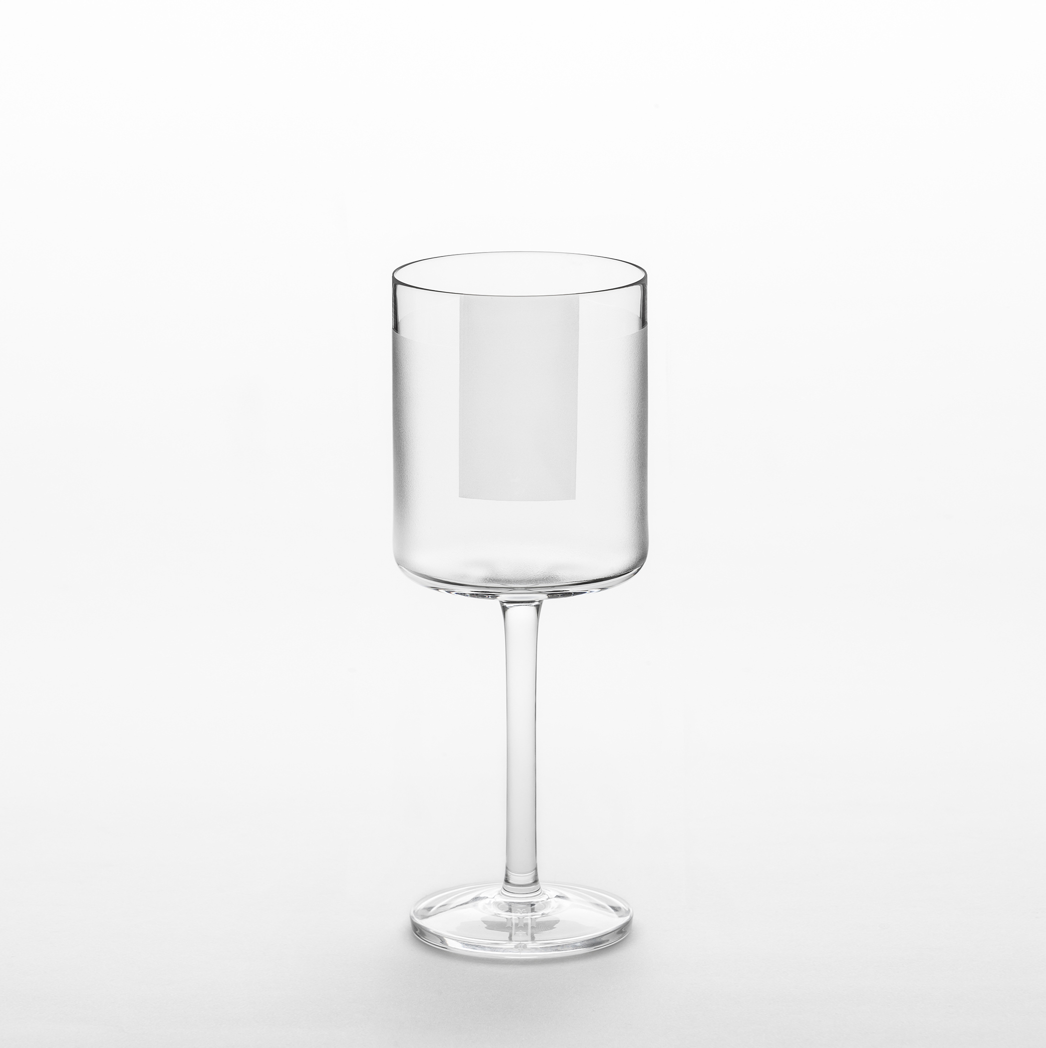 """Element White Wine Glasses - Set of 2 - A rich assemblage of graphic markings defines the """"ELEMENTS"""" series of lead crystal. Cuts and textures of varying depth and intensity are employed across glasses to create a landscape of layered pattern that is fresh and seductive; a whole new take on the decoration of cut crystal. Sold as a set of 2  