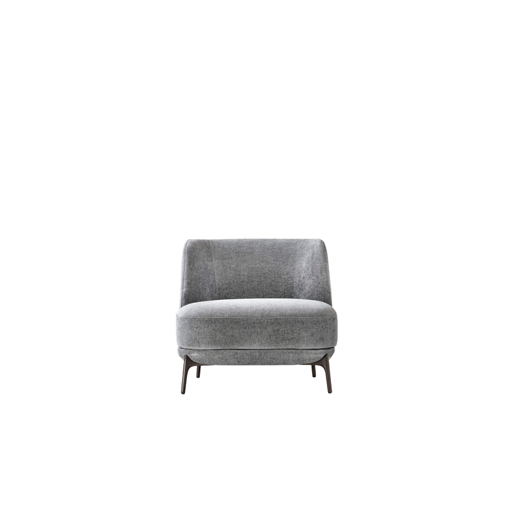 Velvet Armchair - The Velvet armchair is a soft one-piece design with smooth, rounded shapes that mould to the body as it sinks in, offering some quality relaxation time. Raised on bronze-finish metal legs, it can be made with any fabric, leather or imitation leather option from the catalogue.    Matter of Stuff