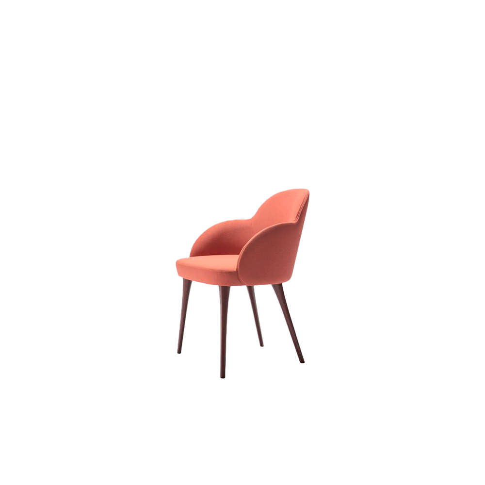 Giulia Armchair - Round, soft and sinuous, Giulia is made of beech wood. The slim legs with a conical shape give an elegant and contemporary style to the armchair.  The upholstery is treated in detail to ensure inimitable comfort and enrich any space with a touch of romance.  Available with metal base. | Matter of Stuff