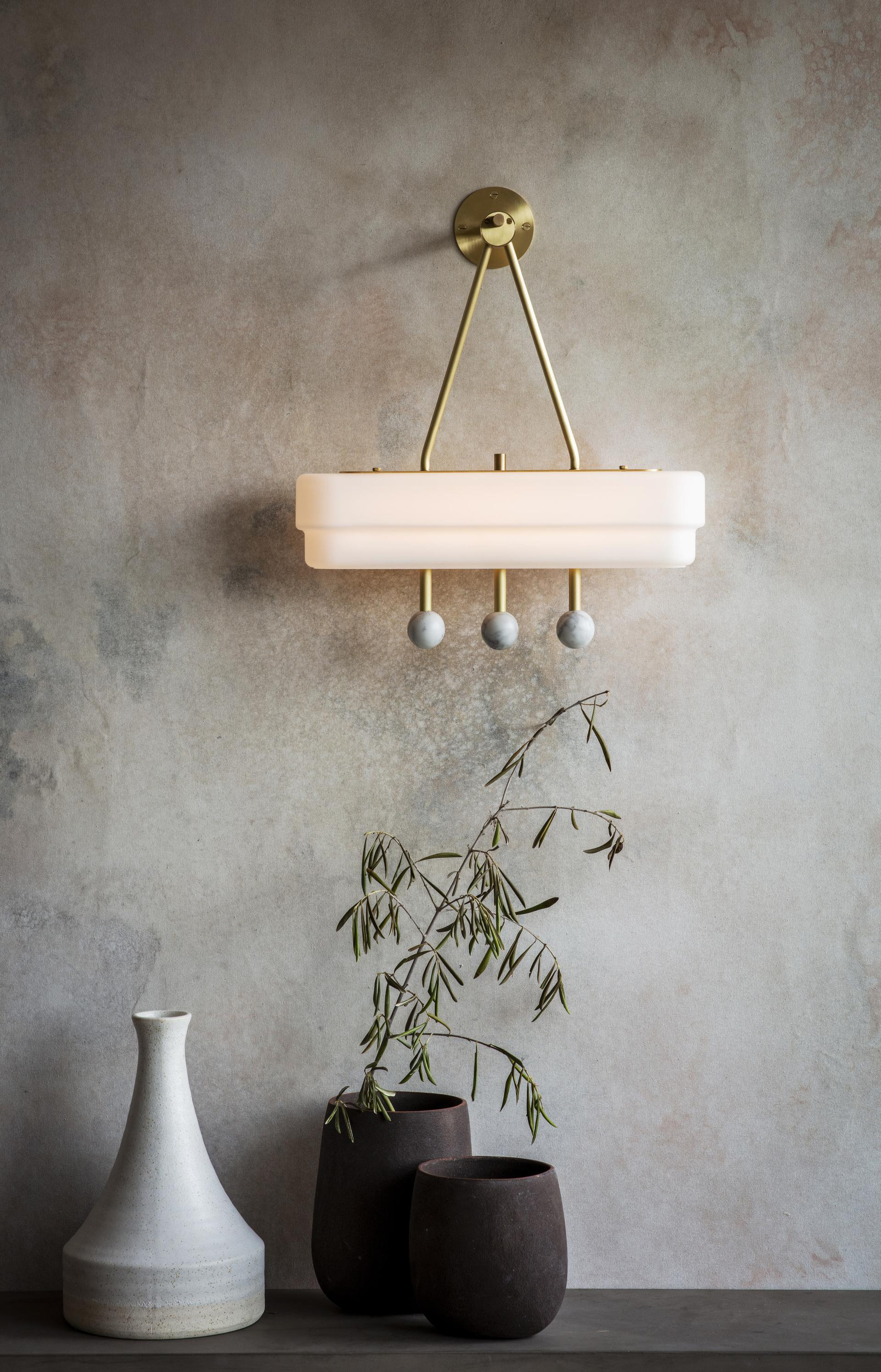 Spate Wall Lamp - <p><span>Showering any space in a gentle wash of light this Art Deco influenced wall sconce features a soft opal stepped glass shade, satin brass metalwork, and opulent marble highlights.</span></p>  | Matter of Stuff