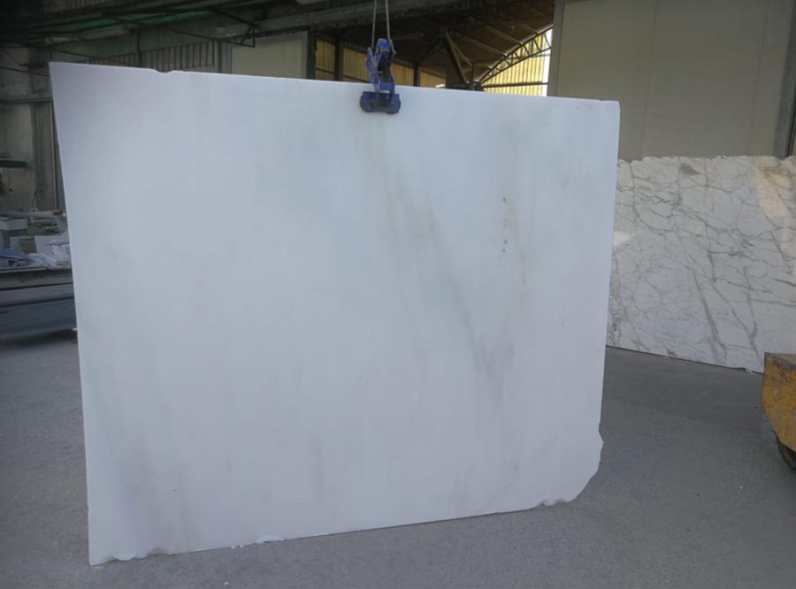 Acqua Bianca B Marble - An aphanitic marble whose pure white background or slightly ivory in color with faint, slender light grey shadows or scarce small dark grey spots, make it the ideal stone for a very large types of applications. The material is very fine-grained and rather compact with small surface pores and sometimes some minuscule crystals that are metallic black in color. Elegant and versatile, Acquabianca Marble may be used in various types of projects as floorings, staircases, facings of many kinds, columns and decorative elements and it is suitable for public or private use. <ul>  <li>Water absorption at atmospheric pressure %: 0,19</li>  <li>Apparent DensityKG/m<sup>3:</sup>2700</li>  <li>Open porosity % : 0,4</li> </ul> | Matter of Stuff