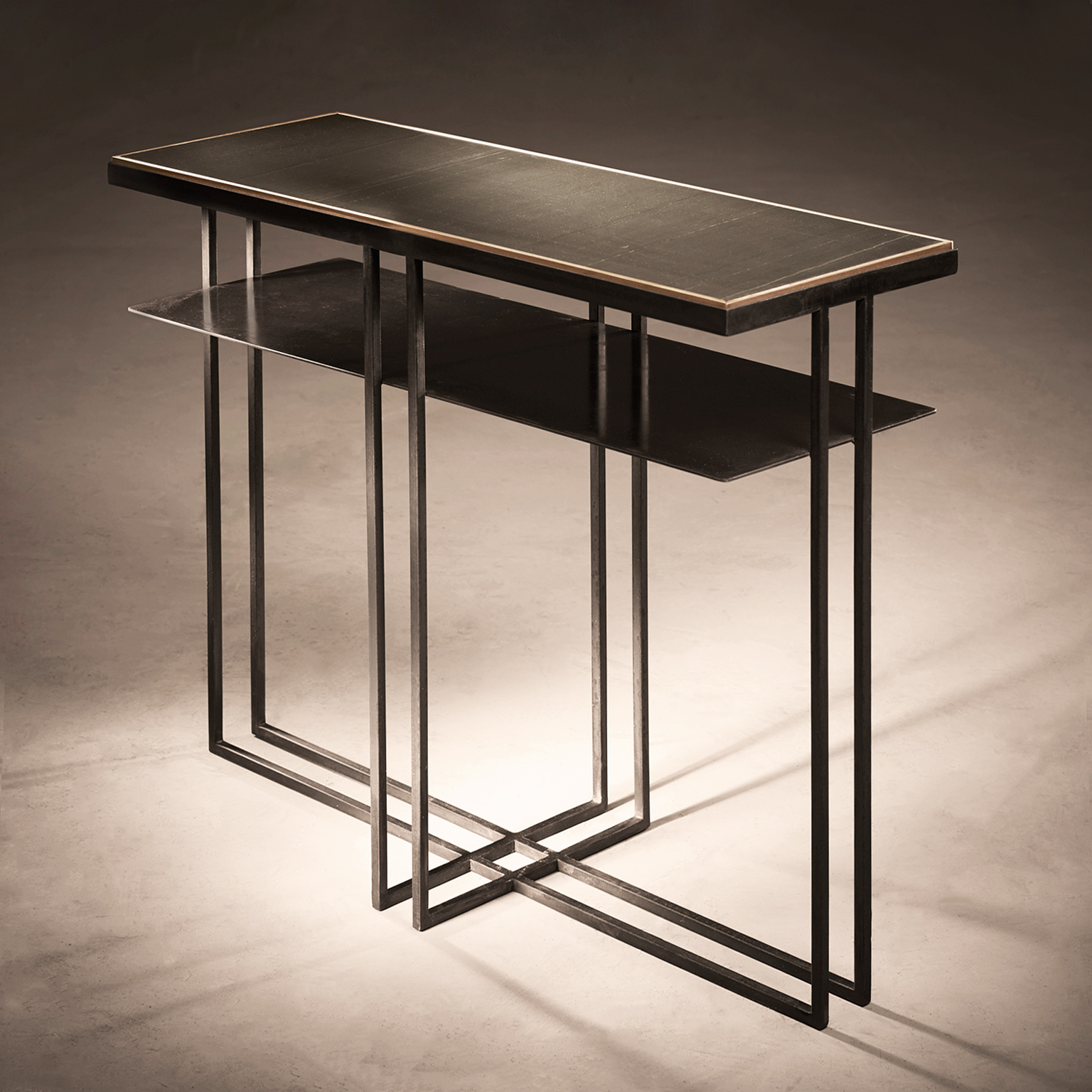 Slate Cross Binate Side Table - This sleek yet industrial side table is similar to the Brass Cross Binate Side Table except the top is made from slate. It has a Blackened Steel Frame, top with honed Cumbrian slate and a polished brass trim. The Slate Cross Binate Side Table is hand made and crafted in the North of England to order. Custom sizes and finishes are available.</p>  | Matter of Stuff