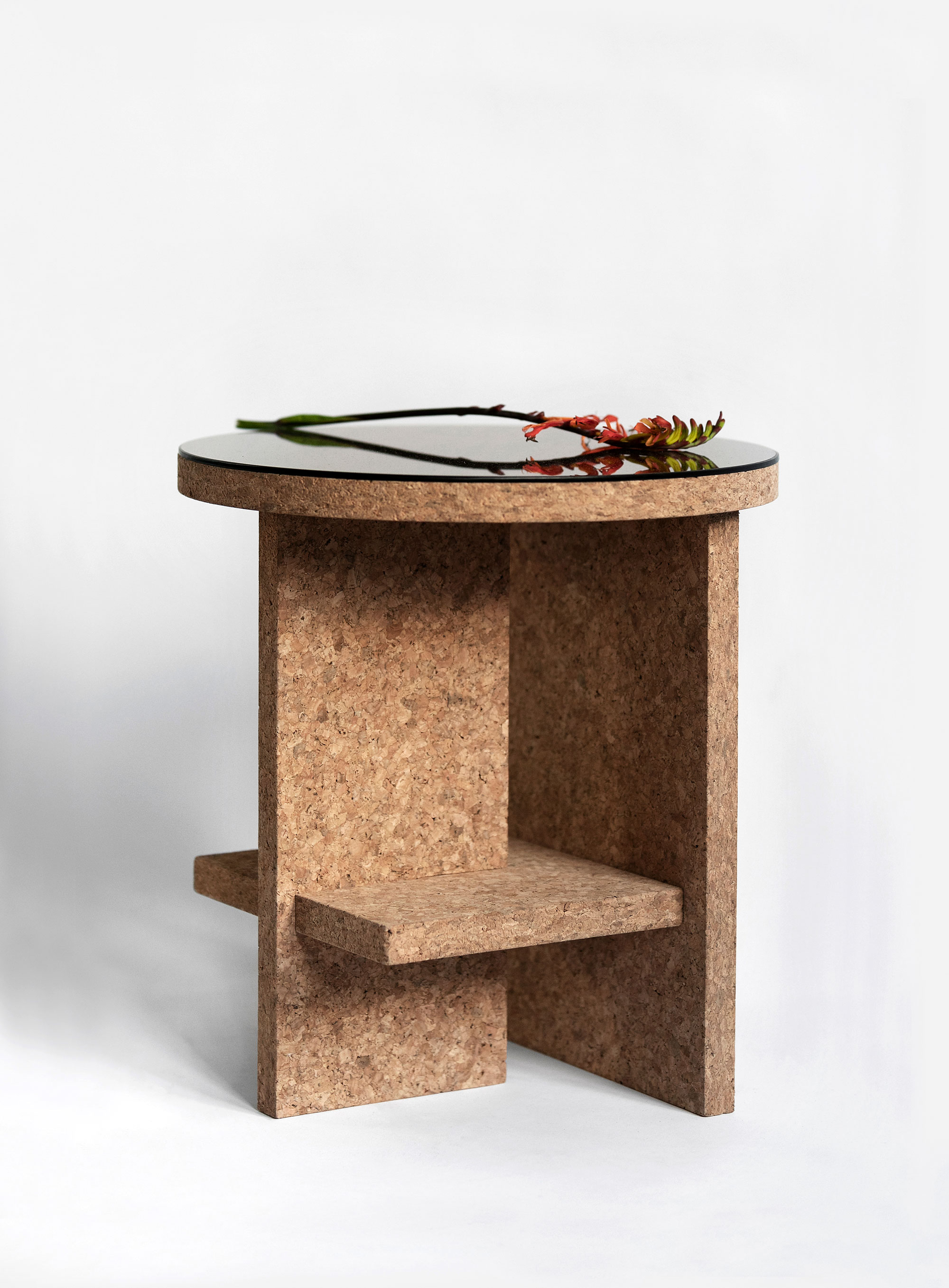 Cruz del Sur Side Table Light Cork - <p>Compact and light, flat-pack side table in Portuguese cork. This special edition designed for Disegno Magazine Cruz del Sur table snaps on together in just seconds without the need of tools, it's made in London using sustainable cork from Portugal and comes in a flat-pack. This mighty but compact table features a shelf for reading books and accessories to keep your tabletop clutter-free. Available in light or dark cork finished in natural oil-wax with the option to add-on a bronze finish mirror top. </p>