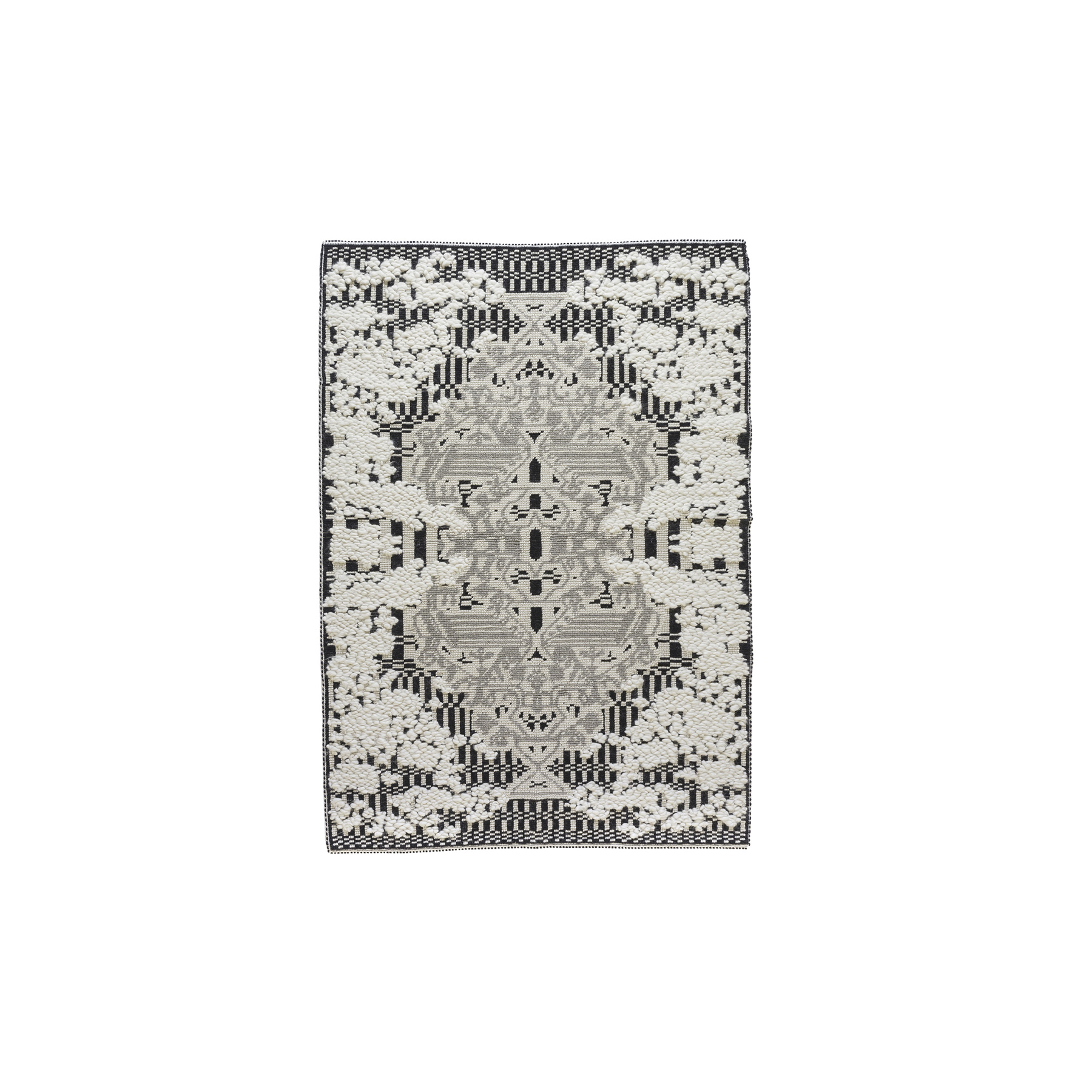 Giardino Fiorito Rug - This elegant and comfortable rug is soft to the touch and its decoration is dynamic and striking, and is achieved with the 'Pibiones' technique, a traditional Sardinian weaving technique with geometric designs that represent a stylized 'blooming bird'. The pure Sardinian wool features three main colours: ivory for the flowers, grey for the bird, and black for the background. In this carpet, tradition and innovation are effortlessly weaved together