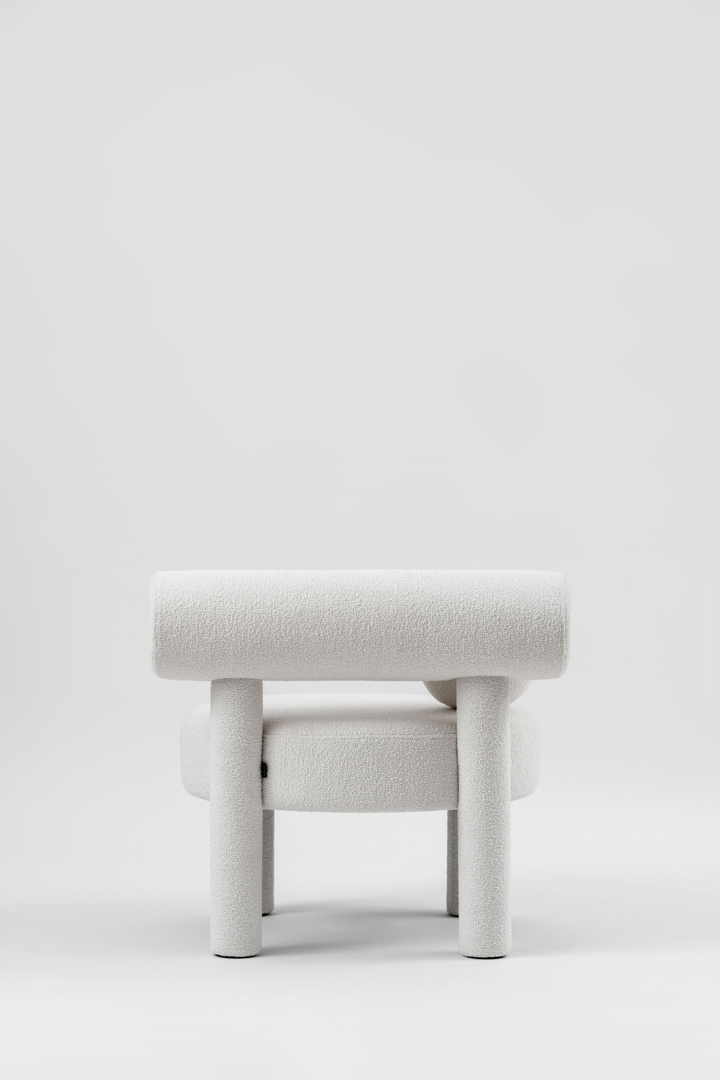 """Low Chair Gropius CS1 in Boucle Fabric - New NOOM furniture collection is dedicated to the 100th anniversary of the founding of the Bauhaus School in Germany. Ideas of functionalism and conciseness, the combination of craft and art, buildings and objects formed by a composition of simple geometric shapes, are still relevant. NOOM furniture is a tribute to the great thinkers who formed the modernist principles and brought them to life.   The designer has """"gathered"""" the shape of this chair from balls and cylinders. A round pillow and an ottoman appeal to interact: to pump, to play, to bubble.  All products in the collection are called by names of famous modernist artists and architects.   Matter of Stuff"""