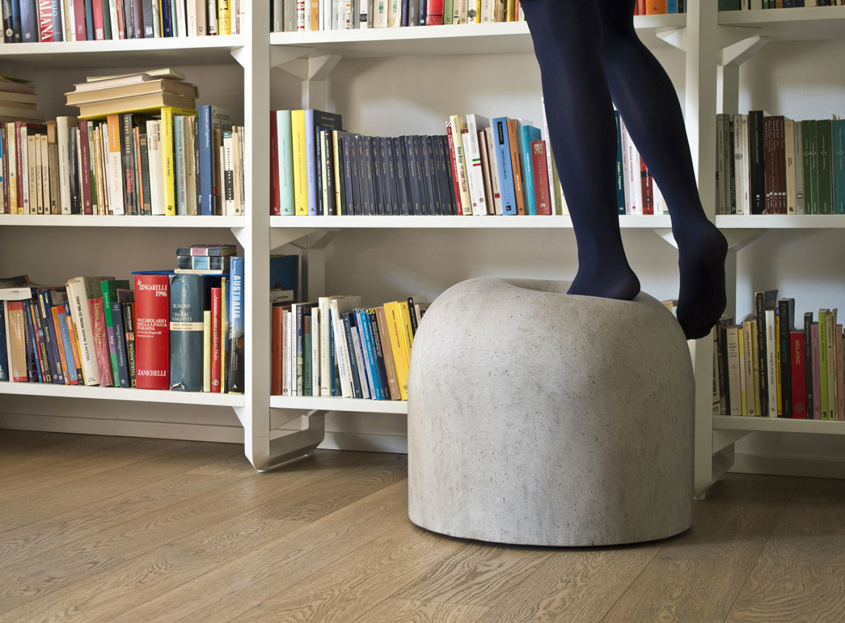 Bard Pouf - <p>A small upholstered furniture item that pays tribute to the city of Milan. The shape and texture suggest the concrete anti-parking bollards found throughout the city, with an ironic surprise: a notoriously hard, uncomfortable object becomes soft and inviting, taking on a new appeal.</p>    Matter of Stuff