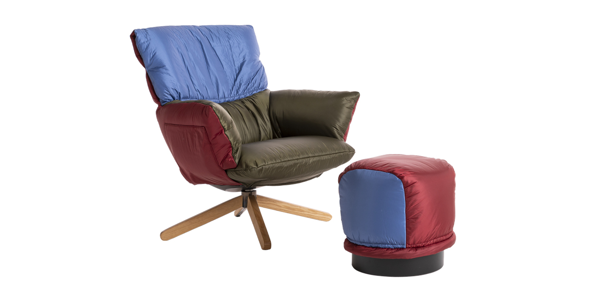 Lud'o Armchair with Wooden Spokes Base - With innovative lines and an ingenious construction, the cozy Lud'o Lounge chair by Patricia Urquiola is an object of design that can be dressed and re-adorned to make room, in our lives, for the playful side of our nature. A change of clothes, in this armchair, becomes a fundamental concept: with a simple gesture – and a pinch of light-heartedness – one can remove the entire padded upholstery that covers the shell and substitute it with a completely new one.  Different chromatic impacts, diverse personalities: the Lud'o Lounge is a whimsical and relaxing armchair. The look can change according to the season or the setting. Lud'o Lounge chairs invite you to slide in and relax with the same ease as when slipping on your favourite coat – whether it's a street culture inspired feather-padded jacket or a tailored overcoat.  The extreme comfort, perfect for domestic settings, and the scenographic impact it provides Contract settings, make the Lud'o Lounge chair a worthy tribute to Vico Magistretti, the celebrated designer's mentor. Equipped with a recycled plastic shell, made with a rotational mold, Lud'o Lounge sits atop a base that is available in several versions: a conical metal swivel base matte varnished in black; four solid ash wood legs (oak stained, wengé stained, or black stained), with four ash wood spokes (oak stained, wengé stained, or black stained). The quilted upholstery is available in a selection of the fabric and leathers in the collection.  Super soft, eloquent and polyhedral, the Lud'o Lounge is completely recycled and recyclable: in this armchair each element, from the base to the padding, expresses a new way to give materials added value.   Matter of Stuff