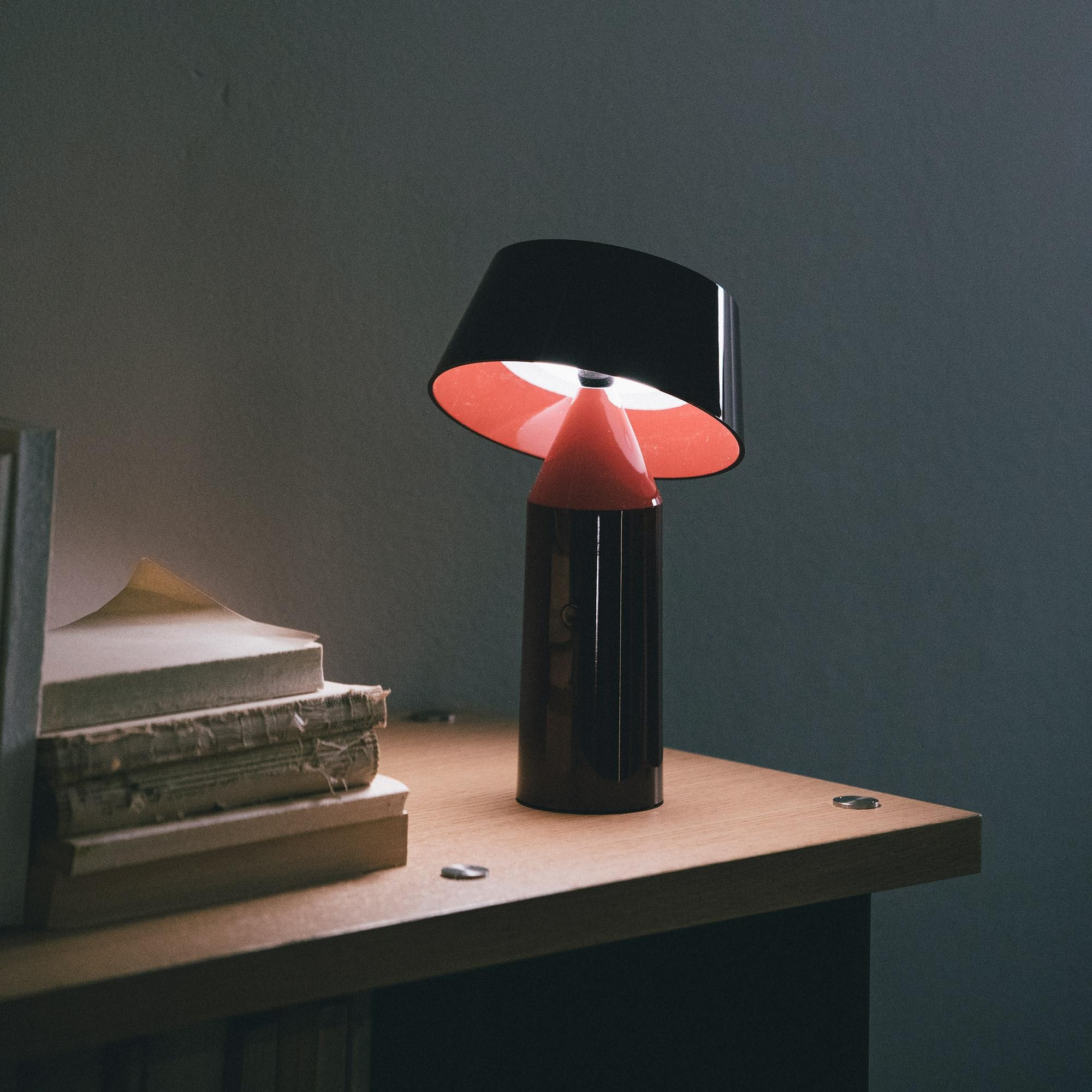 Bicoca Portable Table Lamp - <p>The Bicoca is born with the optimism of brightening life and accompanying the good times, wherever you go. This new colorful, lightweight portable lamp projects an intimate light that adds warmth to all your personal spaces.</p> <p>Made of polycarbonate, Bicoca begins with an overlay of basic geometric figures, with a tiltable shade to direct the light. Three separate accessories increase the applicability and versatility of the lamp. A powerful magnet can be affixed to the bottom of the fixture, allowing you to place it to metal surfaces -even vertical walls- defying gravity. An armchair accessory drapes over armrests, sofa backs, or headboards, so you can bring your Bicoca to all your personal reading spaces. </p>  | Matter of Stuff