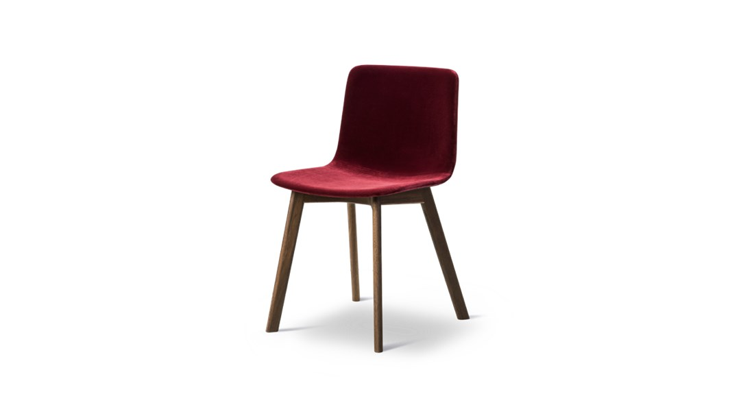 Pato Wood Base Chair Fully Upholstered - Pato is a carefully crafted chair in eco-friendly polypropylene. It can be tuned from basic to exclusive with optional upholstery. With the solid wood base Pato radiates a warm atmosphere in any environment. Pato is a prime example of our focus on sustainability and protecting the environment, reflected in a chair that's 100% renewable and recyclable. All components can be incorporated into future furniture production, thus contributing to a circular economy by minimising the use of materials, resources, waste and pollution.   Merging traditional production methods with cutting-edge technology, Pato is a human-centric, highly versatile series of multi-purpose functional furniture that draws on our in-depth experience with materials, immaculate detailing and heritage of fine craftsmanship. Allowing us to apply our high standards of texture, finish and carpentry techniques to an array of materials in addition to wood for products aimed at a mass market.   With its clean lines and curves, Pato echoes the ethos of Danish-Icelandic design duo Welling/Ludvik. Demonstrating their belief that good design has the ability to be interesting, even when reduced to its most simple form. Where anything extraneous is eliminated and every detail has a purpose.   Together we spent nearly three years developing the shell structure to have a soft surface that's also wear and tear resistant. Enhancing the chair's ability to optimally conform to the user's body is a subtle beveled edge. A technique from classic cabinetmaking, which gives the chair a sense of handcrafted finesse. Each Pato is detailed and finished by hand by our highly skilled crafts people, who refine the beveled edge and the silky, resilient surface. Setting a new standard for the execution and finish of polypropylene.   Since the success of its initial launch, we've expanded Pato into an extensive collection of variants, featuring armchairs, barstools, office swivel chairs and a