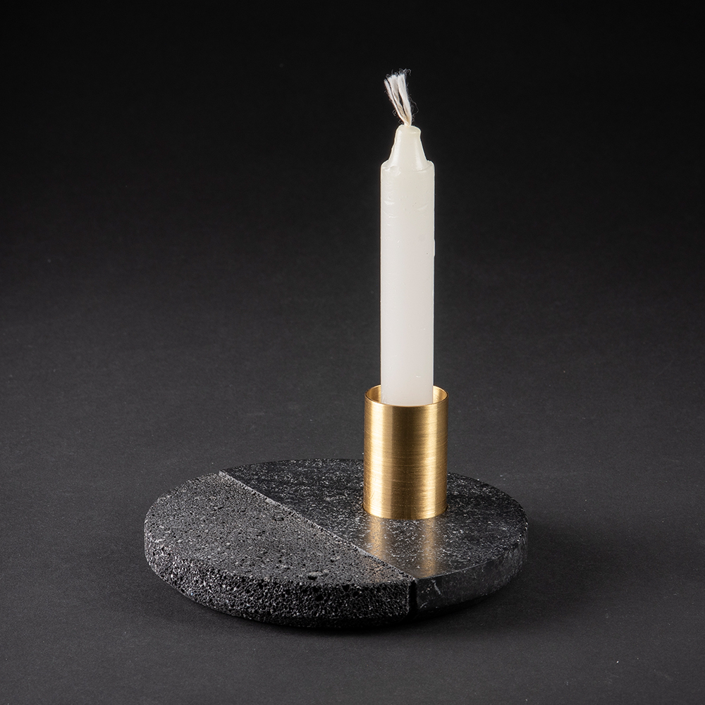 Lava Candleholder - <p>Volcanic rock is a witness to the power of nature: hand–polished by craftsmen with a millenary tradition, its unruly nature is transformed into a sensible and human object. A brass accent completes the harmonious balance and reveals that this piece is as decorative as it's functional. With it's dual texture, the Lava candleholder is as much an homage to Mexican tradition as it is a glance in the direction of modernity. </p>