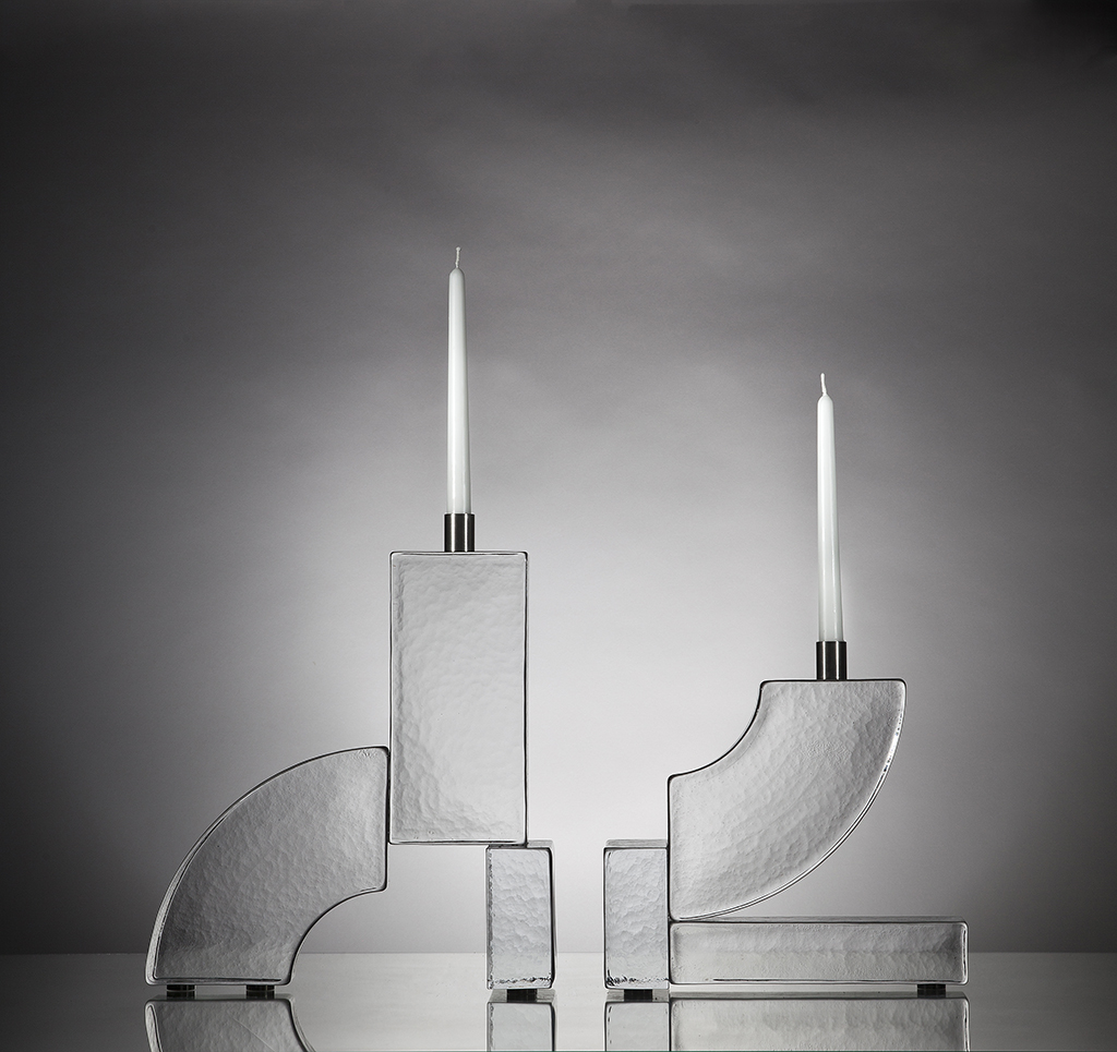 Brick Candle Holders - Nordberg's fascination for the ultra-standardised is materialised in the Bricks series. Glass bricks with the exact measurements of the old traditional bricks are composed into sculptural candle holders. Besides the traditional dimensions of the bricks nothing else is standard – the BRICK series is hand cast in a small Italian glass foundry and patiently assembled in Sweden.