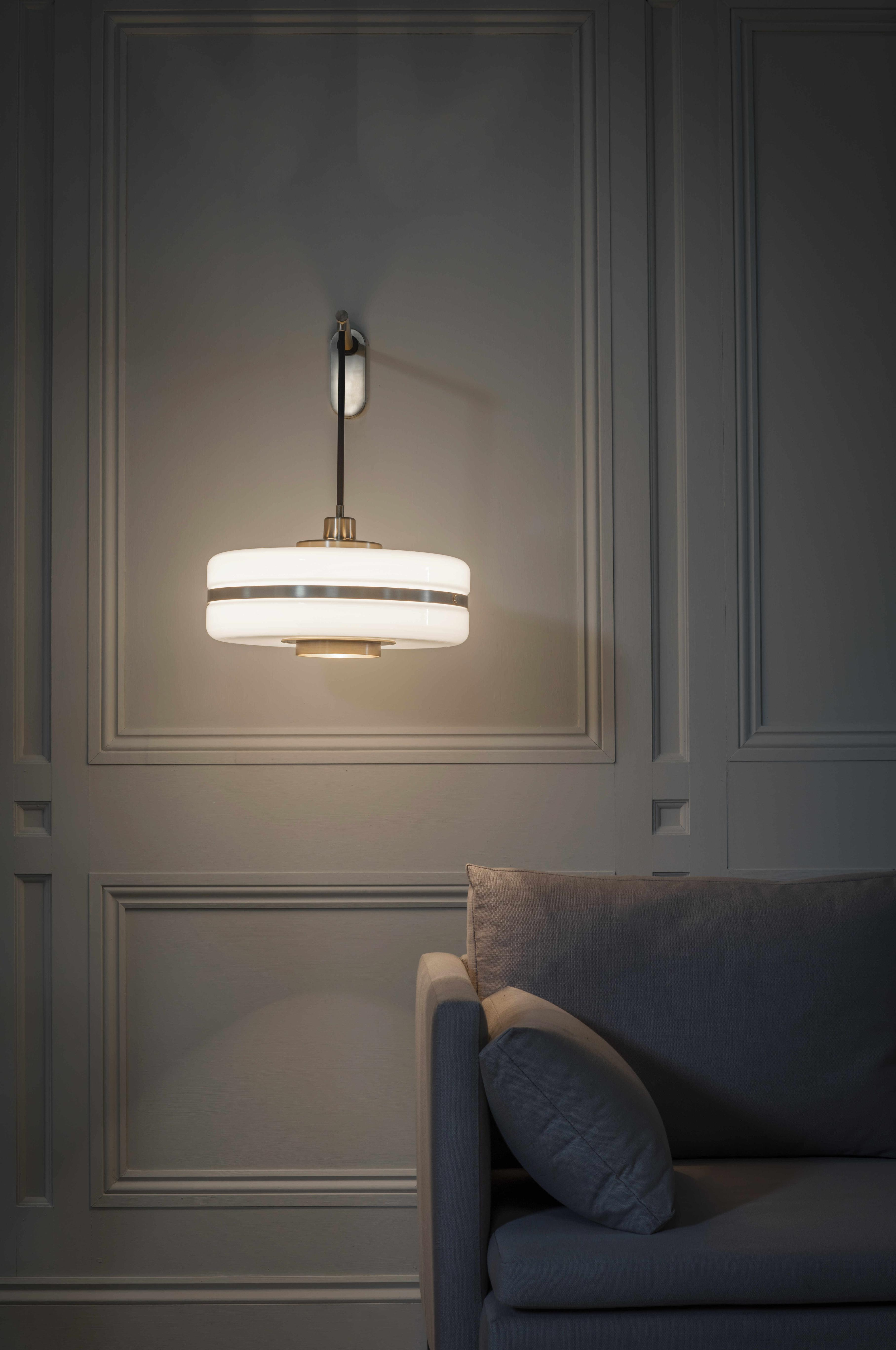 Masina Wall Light - <p><span>A glamorous large opal glass shade is matched with lustrous machined brass detailing in the Art Deco-inspired Masina Wall Light. Suspended from a brass back plate, this refined design casts a soft, warm light. </p> <p></span></p>  | Matter of Stuff