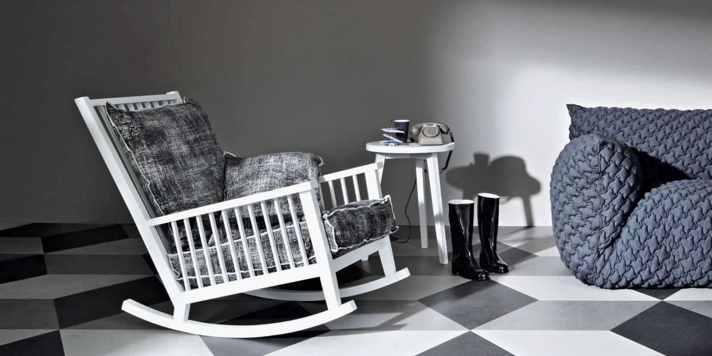 Gray 9 Rocking Chair - The Gray collection is a combination of apparently incompatible elements achieving a result which is contemporary, poetic and attractive. Gray takes inspiration from two styles, the neo-classic gustavian and the scandinavian one from the seventies. Armchairs, sofas, tables, beds and storages are the elements of this line made of a material such as turned and shaped wood, woven fibre, slate, china, marble and mirror. The plain elegance of the XVIII century furniture melts with the sobriety of the scandinavian design, which is more familiar to us. The wooden surfaces are mat and chalky, lead grey and white. grey and white are also the colours f the striped fabrics covering the models and the knit made jacquard patterns used for the cushions. Crochet laces are the decoration of the mirror front doors of the storages. China and natural american walnut are the materials which give harmony to the complete line. <p>Sofas with frame in natural American walnut, natural oak, white or grey or air force blue or black oak; it's accompained with seat cushion with polyurethane foam; suitable for indoor use. Available with upholstered seat and back with polyurethane foam. Removable different types of fabric in different colours. <p>An optional polyurethane back cushion is available in a combination of fabrics and colour. Please enquire for further information.  | Matter of Stuff