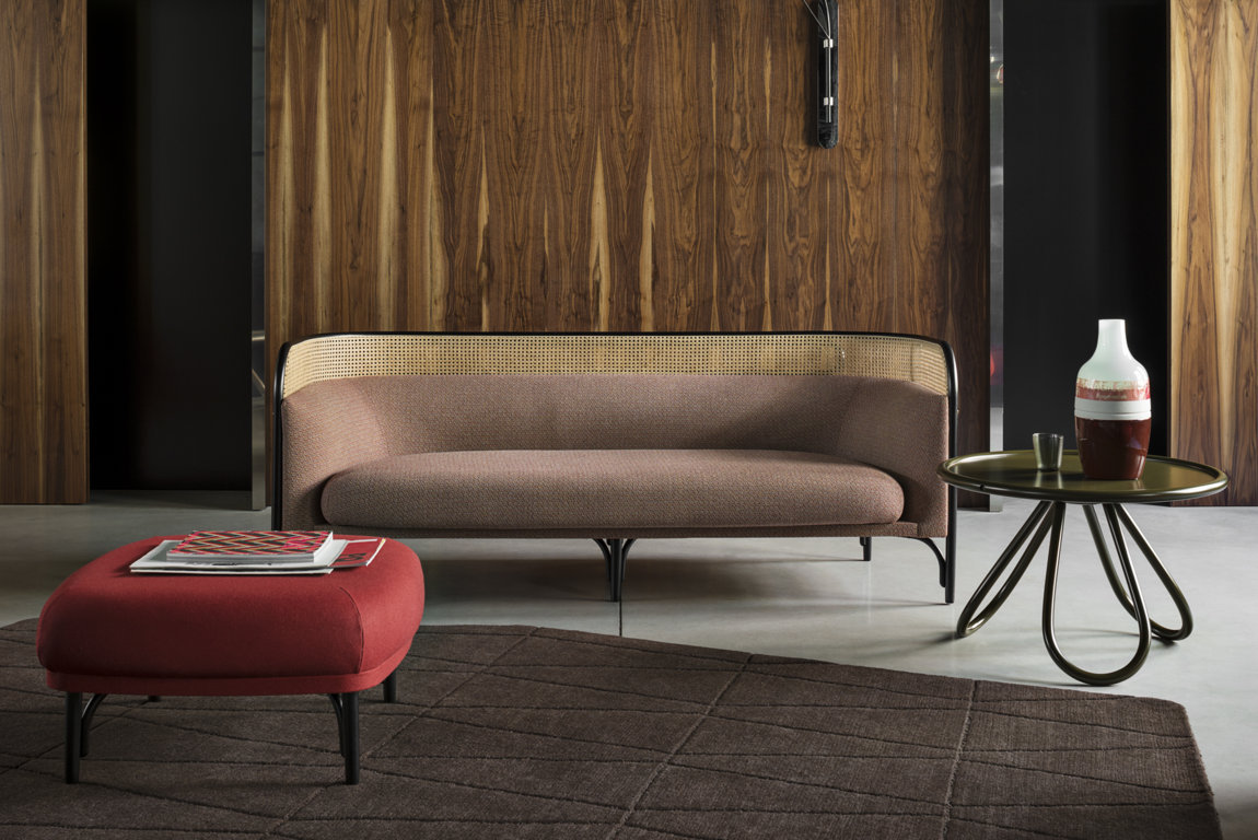 Targa 2 Seat Sofa - Combining the iconic steam-bent beechwood that creates a unique enveloping frame, this sofa was designed by the Italian-Danish designer duo GamFratesi in 2015. Equally stunning in a public space that prefers an intimate effect or as a magnificent statement in an eclectic home, this sofa will be eye-catching. Mixing sinuous curves and straight lines, plush cushions and minimalist accents, this piece will make a statement in any interior.