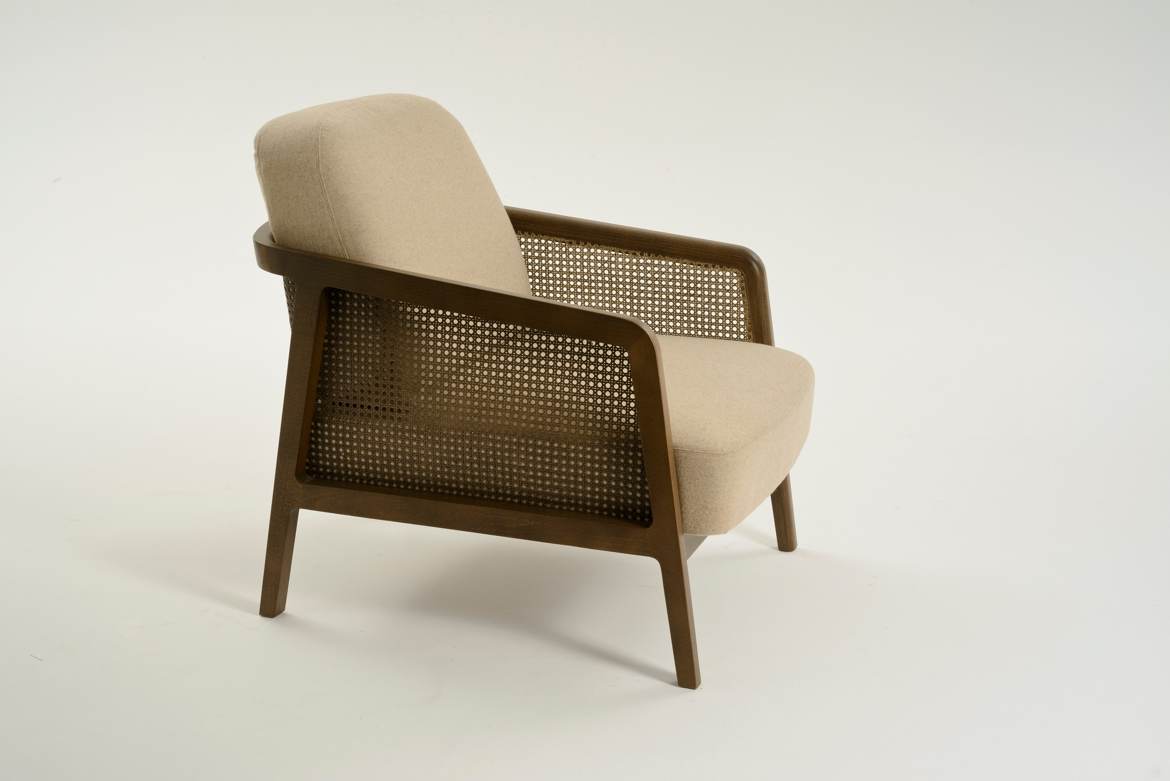 """Vienna Lounge Armchair - A living room armchair in wood and straw, that recalls the exclusive Viennese club atmosphere at the end of 19th century but in a contemporary key. Vienna is an extraordinarily comfortable and elegant lounge armchair designed by Emmanuel Gallina who loves to quote Brancusi when saying that """"simplicity is complexity resolved"""". A tribute to the renowned Italian talent constantly aiming to harmonise beauty and functionality. A range of fabrics and colours are available for the upholstery, prices may vary. Please feel free to contact for full details and other enquiries. 
