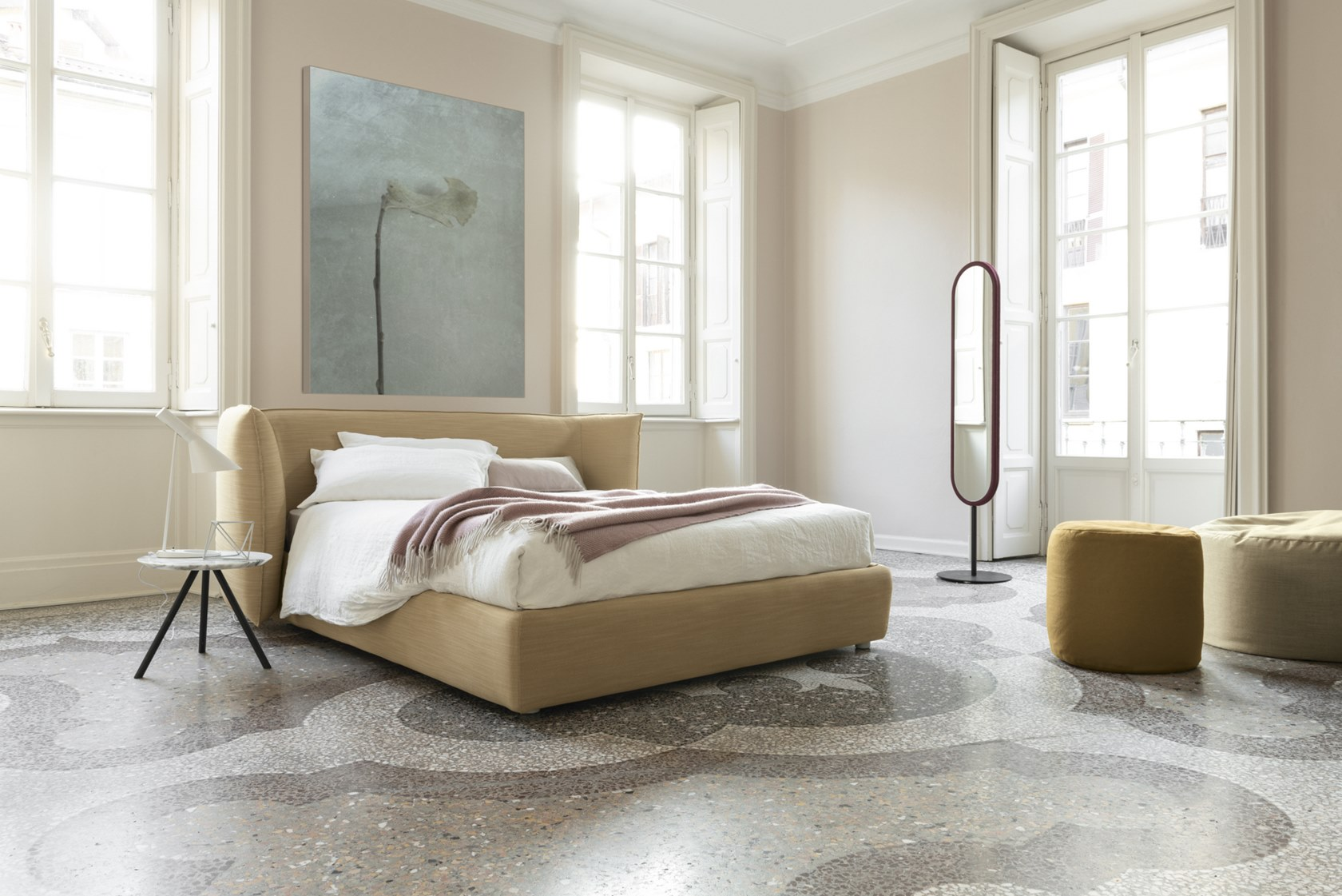Jill Bed - Jill envelops thoughts and dreams by the embrace of its headboard, creating a comfortable intimate atmosphere. Its soft and generous shapes have a leading role in the night space, dominating also the room center.   All beds are available in different sizes and frame options. Please enquire for more details.   Matter of Stuff
