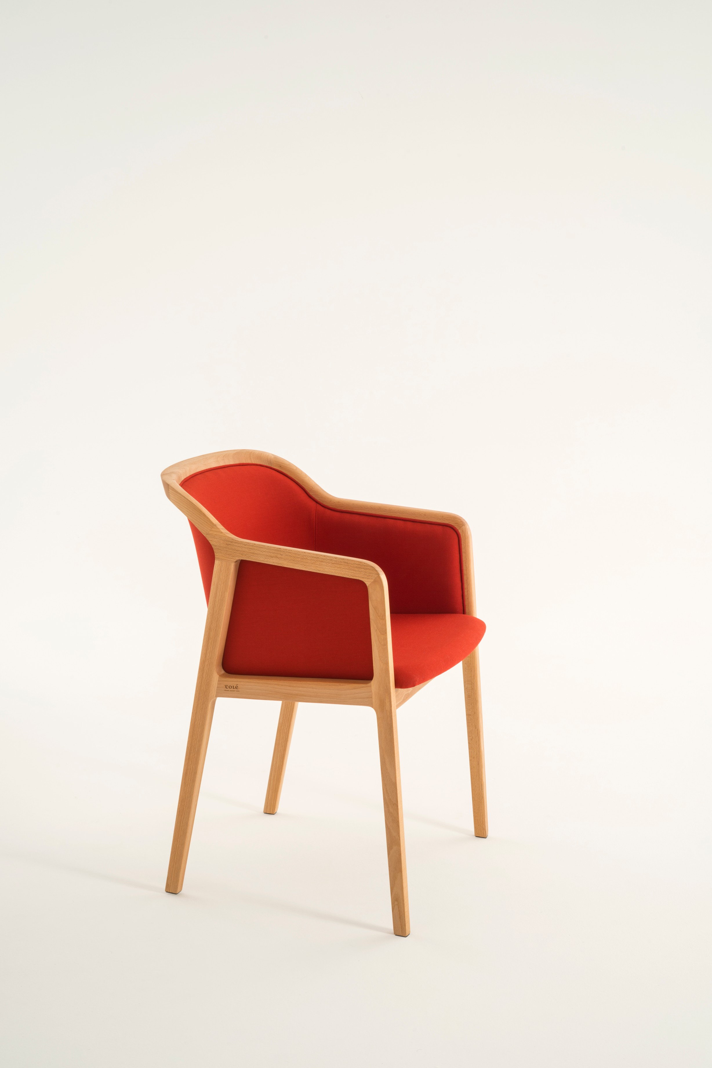 """Vienna Soft Little Armchair - Vienna is an extraordinarily comfortable and elegant armrest chair designed by Emmanuel Gallina who loves to quote Brancusi when saying that """"simplicity is complexity resolved"""". Inspired to the 50's of Marcel Gascoin, but also to Vienna at the end of the 19th century. A tribute to Alfred Sloan's American pragmatism joined to European styling and, in this particular case, to the renowned Italian talent constantly aiming to harmonise beauty and functionality.  UPHOLSTERY A range of fabrics and colours are available for the upholstery, prices may vary. Please feel free to contact for full details and other enquiries.    Matter of Stuff"""