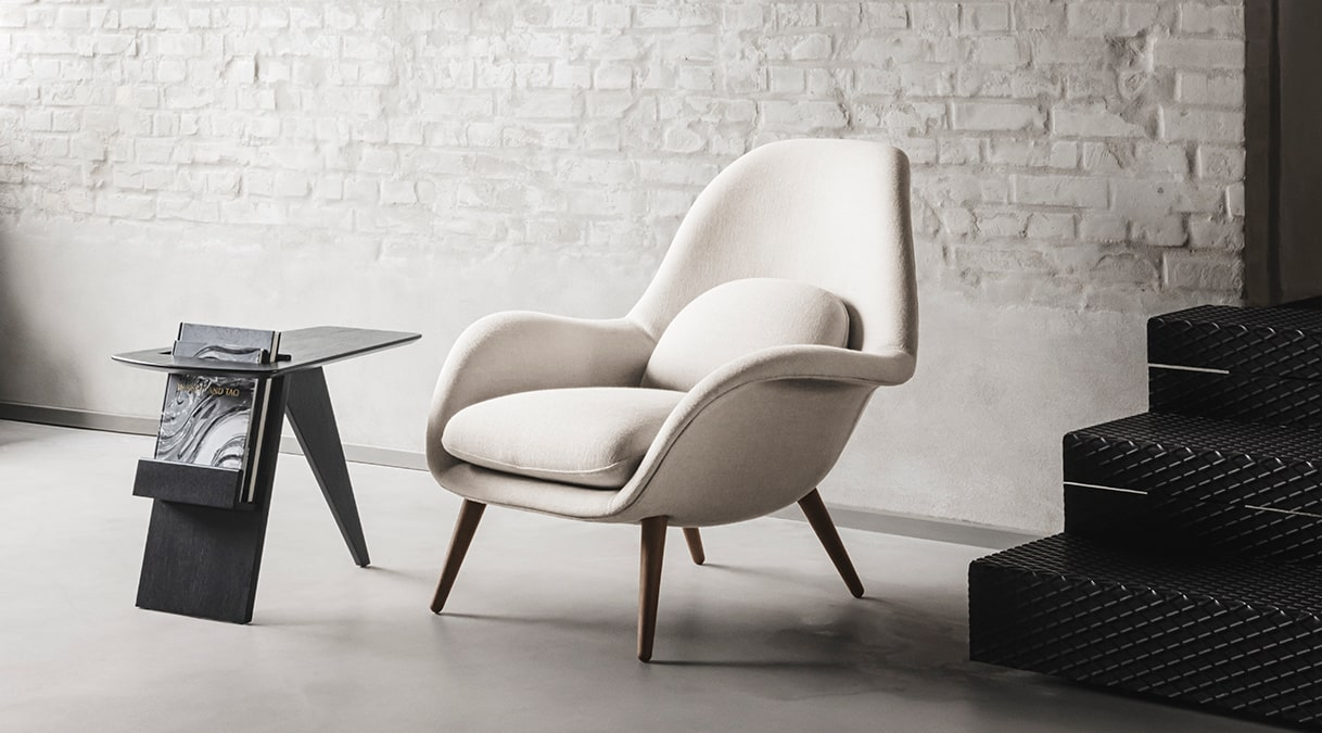 Swoon Lounge Chair - Space Copenhagen designed the Swoon Lounge Chair to fill the gap between a conventional lounge chair and a typical armchair. Explore Swoon Lounge Chair here. With its continuous curves, lush look and sculptured shape, Swoon echoes Space Copenhagen's desire for you to enjoy life at a slow pace.   Originally launched for the 11 Howard Hotel in New York, the Swoon Lounge is an open invitation to luxuriate in comfort. Based on their extensive experience designing high-end hotel interiors and Michelin-star restaurants, Space Copenhagen created Swoon to fill a gap missing in the market – a hybrid of a lounge chair and an armchair with the benefits of both. The singular shell merges the back, seat and armrests into one entity, allowing for exceptional support and a fit that feels natural. The seat and back cushions are also attached as one piece for endless hours of comfort.   Swoon is suitable for hotel lobbies, VIP suites, restaurant reception areas, upscale bars, lounges and private residences.   Of course, the perfect companion to any lounge chair is an ottoman. The Swoon Ottoman not only adds to your ability to stretch out and relax even more, it's a decorative element in its own right. Ideal as a pouf for punctuating any space with style.   Look for the same casual take on elegance in the Swoon Lounge Petit. Slightly smaller in size, it features a high back designed at a more upright angle. The result is a chair that invites you to unwind, making it conducive for conversations or working on your laptop. | Matter of Stuff