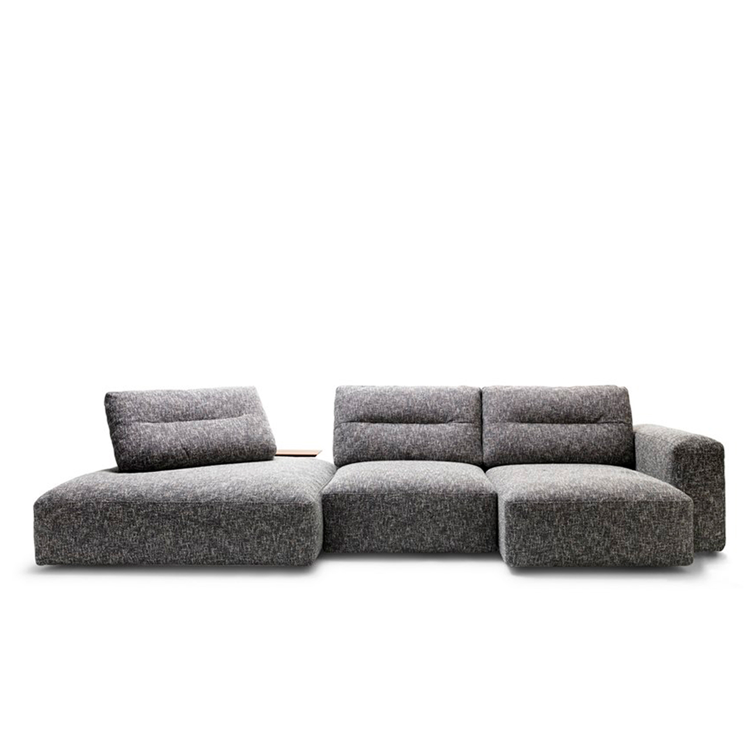 My Taos Modular Sofa - My Taos is the sofa design that best communicates Saba's identity. Its recent redesign is based on the 4 pillars of the company: memory, comfort, design and poetry. My Taos stays true to its original design by maintaining the element of fluidity in the movement of the pouf structures. Improved comfort has redefined the heights of the back structures and improved the ergonomics using the latest generation of materials. This new design has also altered the fold-out side tables and new cylindrical support cushions. The element of poetry in the updated design has rounded the overall form, softening all edges and lines. My Taos sofa epitomizes how an excellent design stands the test of time.  This is a modular sofa so it is available in various sizes and combinations. Please enquire for more information and prices.   Materials Structure in wood and steel padded with polyurethane and memory foam. Upper mattress in goose down covered with 100% cotton fabric. Feet in wood with non-sliding plugs. The seats of central and chaise longue elements are provided with feet in wood with on-sliding plugs ans wheels. The seat cushions are made with polyurethane and memory foam, upper mattress in goose down covered with 100% cotton fabric. The black cushions are padded with Mollapiuma (50% goose down and 50% dacron DuPont fiber) covered with 100% cotton fabric. The roll cushions have got polyurethane foam core with black painted metal insert and polyester fiber coating. | Matter of Stuff