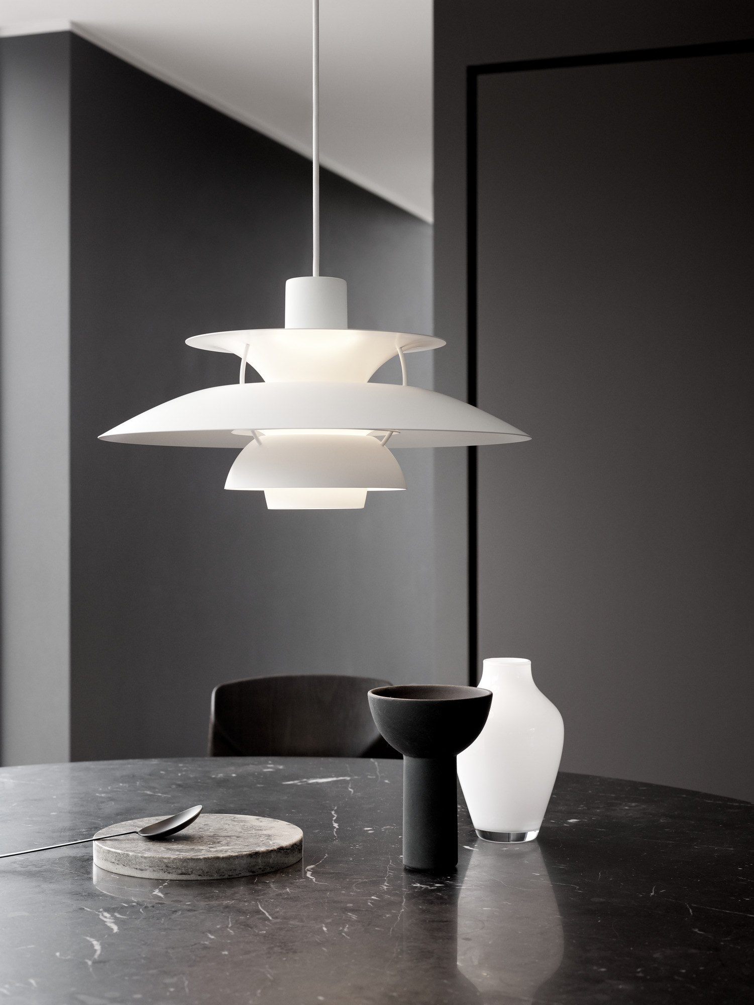 PH 5  Pendant Light - The fixture provides 100% glare-free light. Poul Henningsen developed the PH 5 in 1958 as a follow-up to his celebrated three-shade system. The fixture emits both downward and lateral light, thus illuminating itself. In the PH 5 Classic, a warmer tone of light is created by the inside red cone and a small blue reflector. | Matter of Stuff