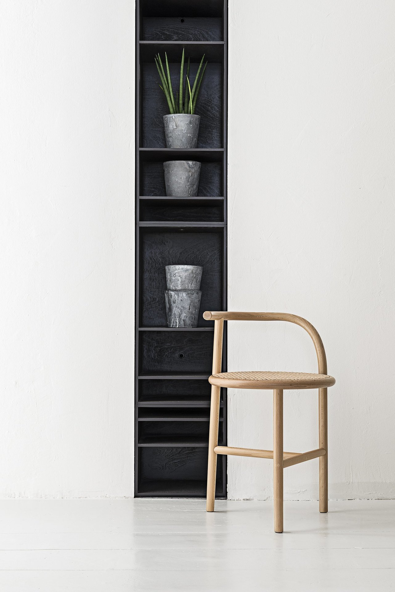 Single Curve Stool - Asymmetry and a minimalist sensibility mix with the iconic features of Viennese bentwood furniture to create a unique stool that will add a charming touch to a modern or contemporary decor. Designed in 2015 by Nendo, this piece is part of the Single Curve collection, hinting to the traditional brand's structure in steam-bent beechwood. The Viennese straw seat adds elegance to the piece.  | Matter of Stuff