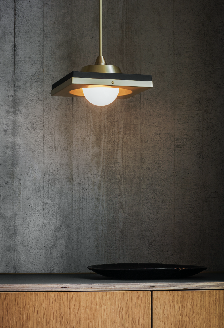 Kins Pendant Light - <p><span>The Kins is a simple yet striking pendant. The sharp geometric brass shade is contrasted by its white opal glass globe which creates a subtle and atmospheric glow in any given space.</p> <p></span></p>  | Matter of Stuff