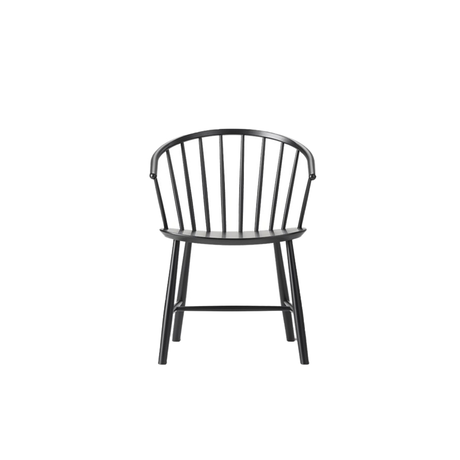 J64 armchair - Johansson's chair draws a parallel to traditional Windsor, as well as Nordic folk furniture. The curved chair with sloping arms works as a comfortable dining chair, or a lounge chair facing a sofa. | Matter of Stuff