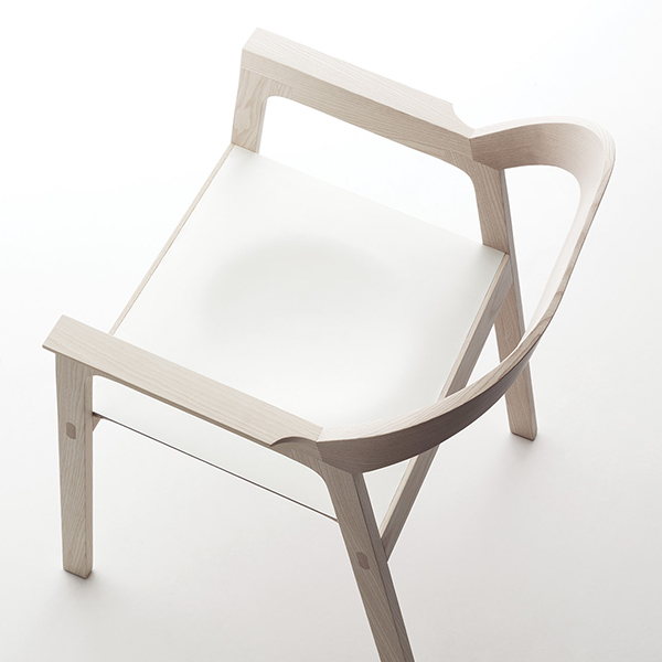 """Diade Armchair - <p>Chair with ash structure and leather seat.<br /> New shapes and interpretations of the substance get married in the purity of the lines of the armchair """"Diade"""": a unique sign, a clever match of curves and design which elegantly characterise the environment where it is located.</p>  