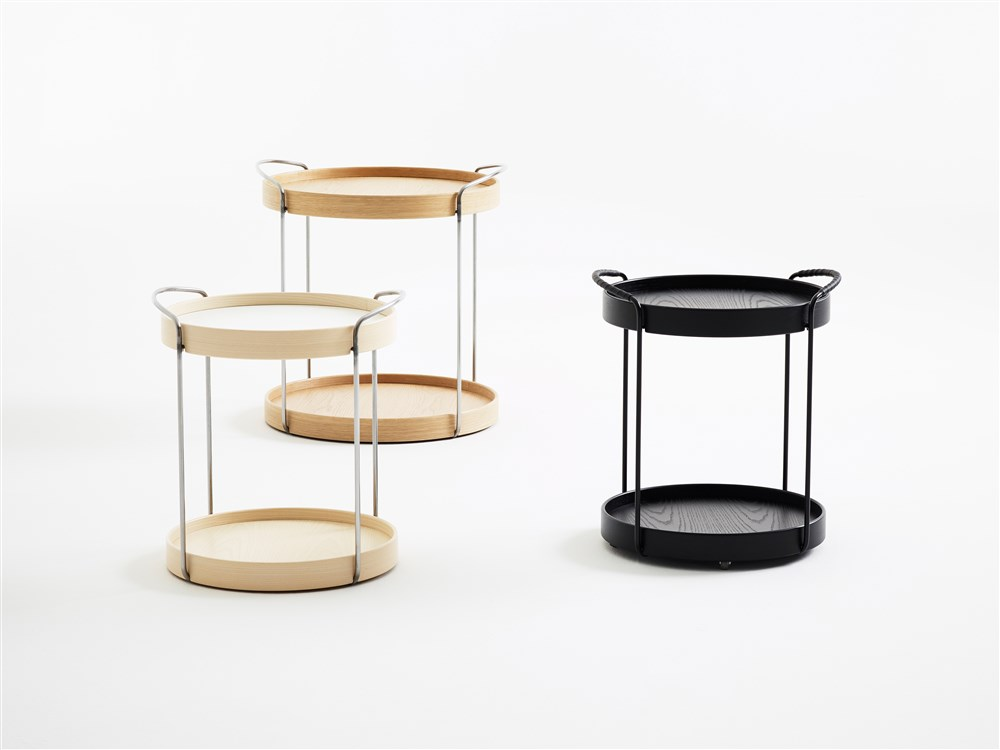 Trayo Table Tray - <p>Trayo (2019) tray table has been designed with a firm focus on function and user-friendliness – a small table that is easy to serve from, to lift, to roll and to take with you. While the design owes much to that of a classic tray table, Trayo offers more functions and is manufactured in other materials – a metal that contrasts with the wood's warm round shapes.</p> <p>Trayo comes in two sizes: 400 mm diameter/height 450 mm and 500 mm diameter/height 520 mm. The table's unique feature is the opportunities it offers to combine the wooden ring, the tray and the metal frame in different ways.</p> <p>The wooden rings are available in compression-moulded oak or ash, standard stains on ash and white-glazed oak or ash. The round trays are in MDF, veneered with oak or ash, with black and white laminated finishes, in standard colours, standard stains on ash, or white-glazed oak or ash. The metal frame comes in a matt chrome finish or lacquered in our standard colours.</p> <p>Optional extras: concealed castors that can be fitted to the lower tray, and handles wrapped in black or brown leather from Tärnsjö. The table is delivered assembled.</p> <p>Trayo has been designed and constructed to be easily moved in everyday situations. Use it as a side table next to the sofa, as an extra table or for serving food on the patio when the weather permits. The loose tray is ideal for fetching more snacks or drinks from the kitchen when the need arises.</p> <p>A range of materials, finishes, colours and accessories are available in a variety of combinations. Please enquire for more information.</p>  | Matter of Stuff
