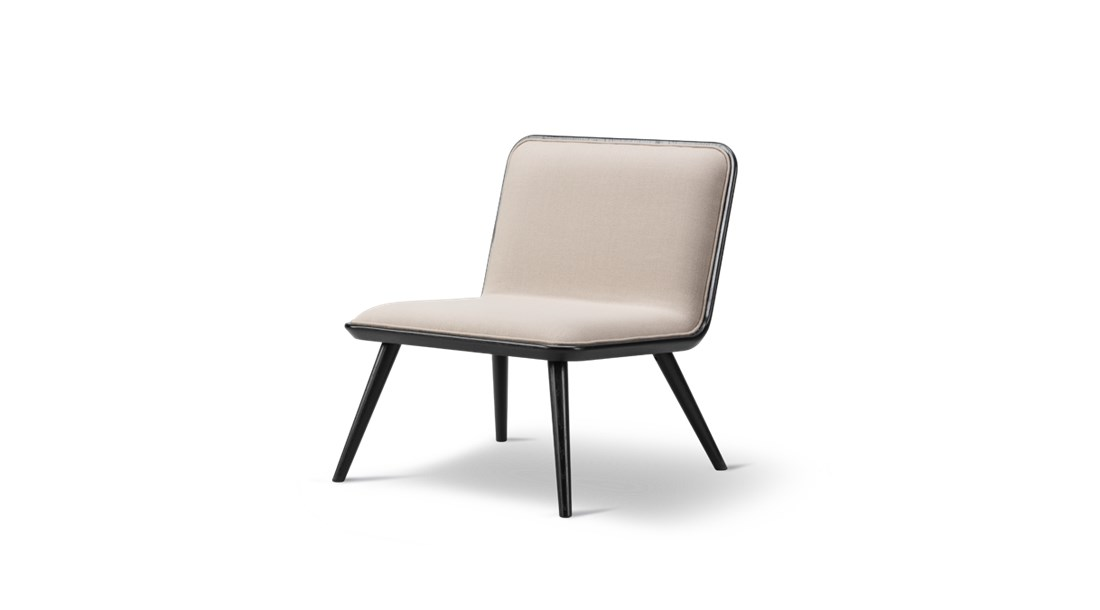 Spine Wood Base Lounge Chair Front Upholstered - Spine Lounge Wood Base is a light lounge chair for residential homes or open lounge areas. The accented detailing on the front upholstered seat in leather or textile combined with a back in oak makes the chair as beautiful standing mid-room as it is against a wall.  Curved corners, ample cushions and somewhat low to the ground, Spine Lounge is a testament to simplicity as the ultimate form of exclusivity. What began as a Spine Lounge Chair for a Michelin-star restaurant has expanded into an entire series with the same signature approach, encompassing the Spine Lounge Suite, Spine Petit, Spine Daybed, Spine Sofa and Spine Bench. An array of variants that easily lend themselves to all kinds of scenarios in the high-end hospitality and retail sector, as well as private residences.   What they all share is a soft, plush cushioned side for comfort supported by a singular structure in solid wood. Incorporated into the structure are slightly splayed legs at either end, which signal a sense of relaxed informality.   The upholstery draws on Fredericia's signature techniques, with a modern spin. Discrete details on various versions, such as the leather piping around the sides, add to the series' subtle sophistication.   The result is a succinct design that's soft yet solid. Fluid yet structured. Poetic yet purposeful. Able to exude, at a glance, an ambience of elegance.  | Matter of Stuff